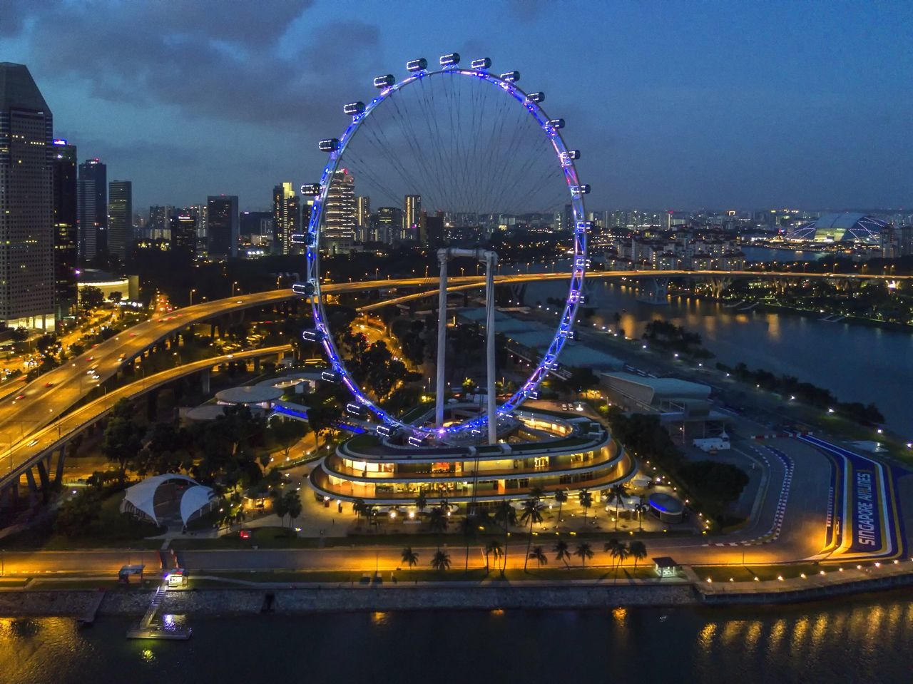 City Architecture Illuminated Bridge - Man Made Structure Building Exterior Transportation Night Skyscraper River Traffic Cityscape Travel Destinations Outdoors Built Structure Ferris Wheel Modern Sky Futuristic No People Connection Droneshot Dronephotography Singaporeflyer Nightphotography Cityscape