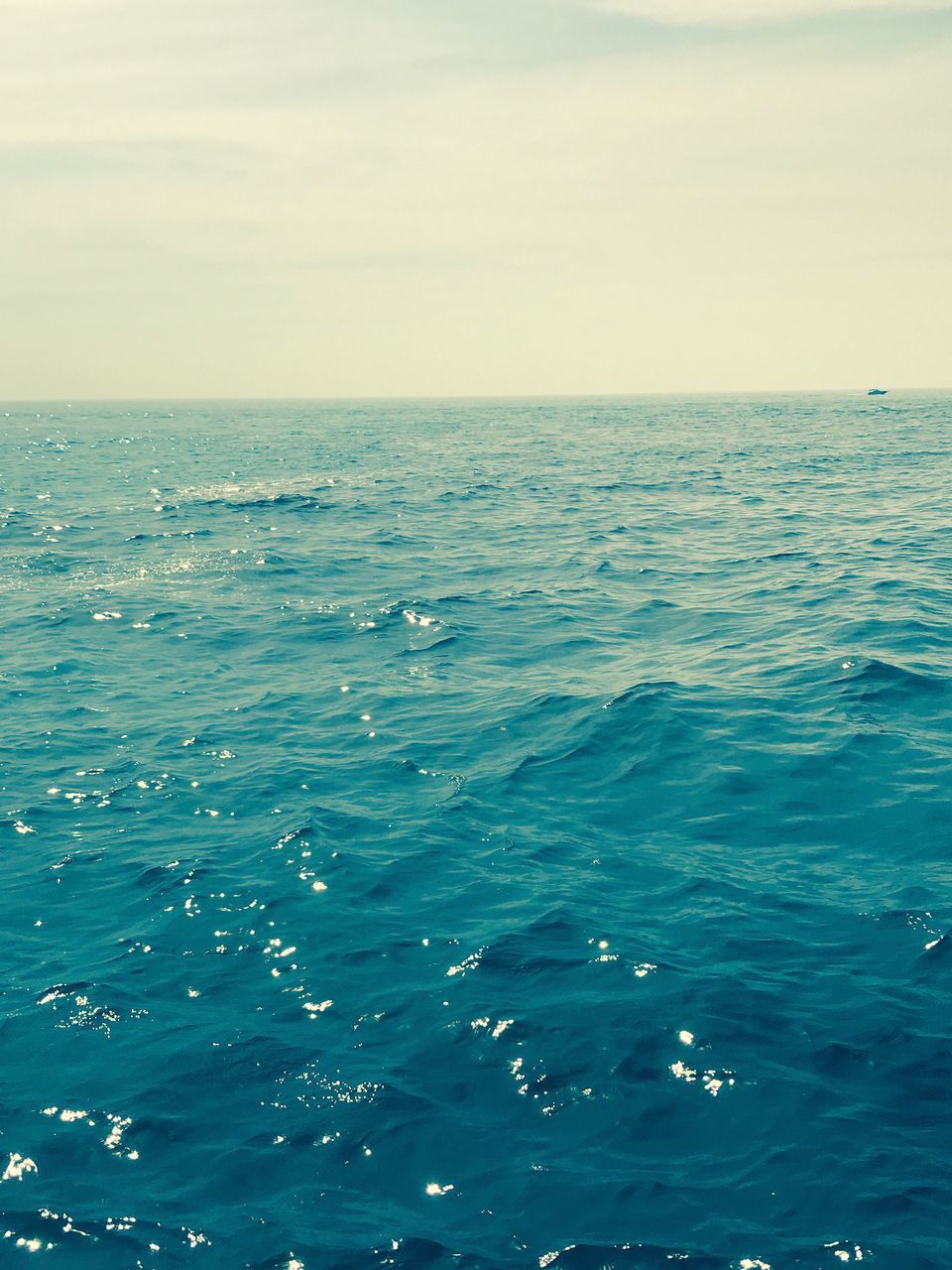 sea, water, horizon over water, nature, beauty in nature, tranquility, scenics, tranquil scene, no people, rippled, sky, outdoors, waterfront, blue, day, clear sky, close-up