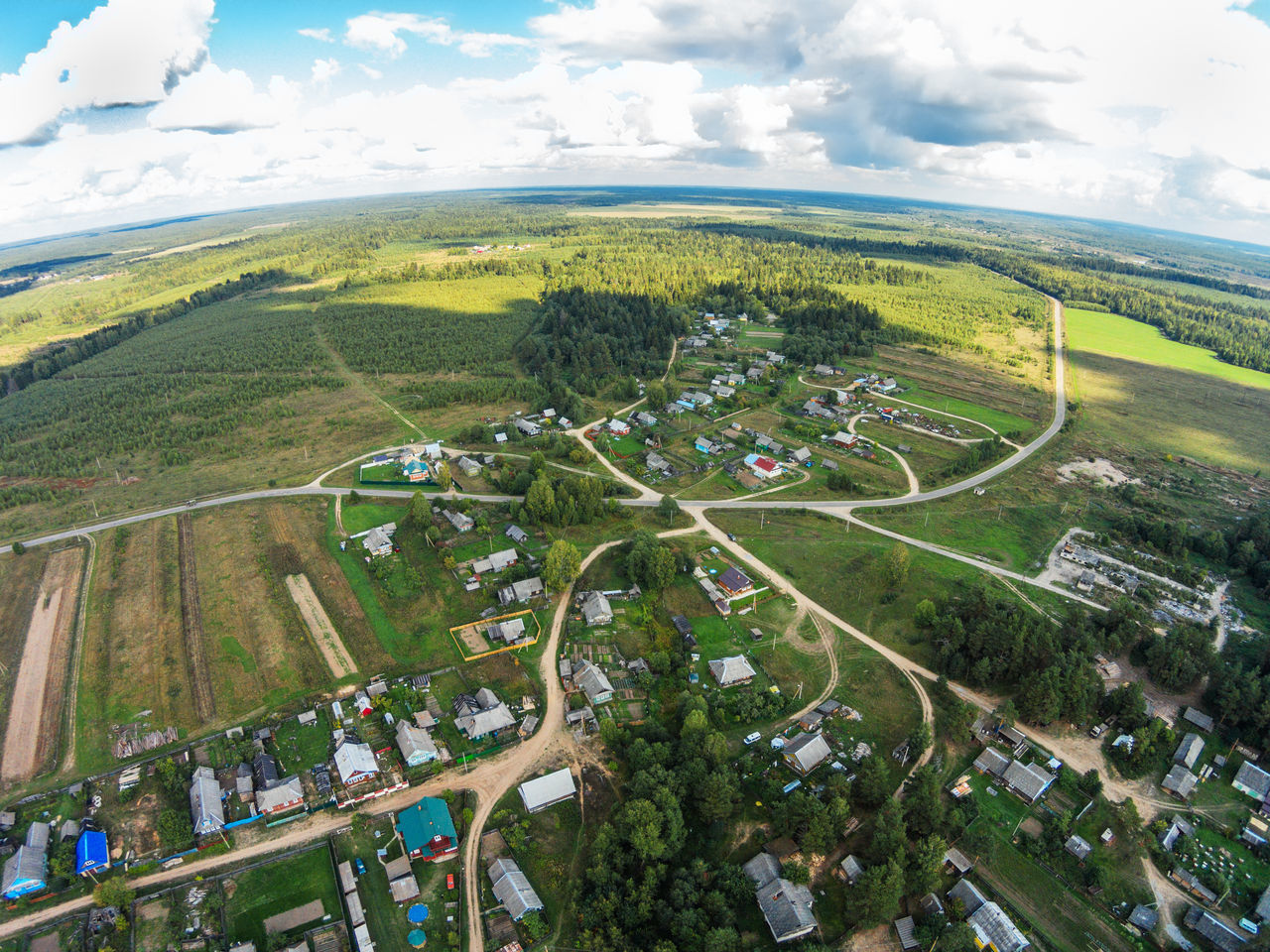 "One of the villages Maksatihinsky area. View from the bird's-eye view of the village, called ""Fabrika"". A Bird's Eye View Aerial Aerial View Agriculture Architecture City Cloud - Sky Dji Dji Phantom Dronephotography Fabrika Fields Grass Green Color Landscape No People Outdoors Patchwork Landscape Road Rural Scene Russia Sky Tree Village"