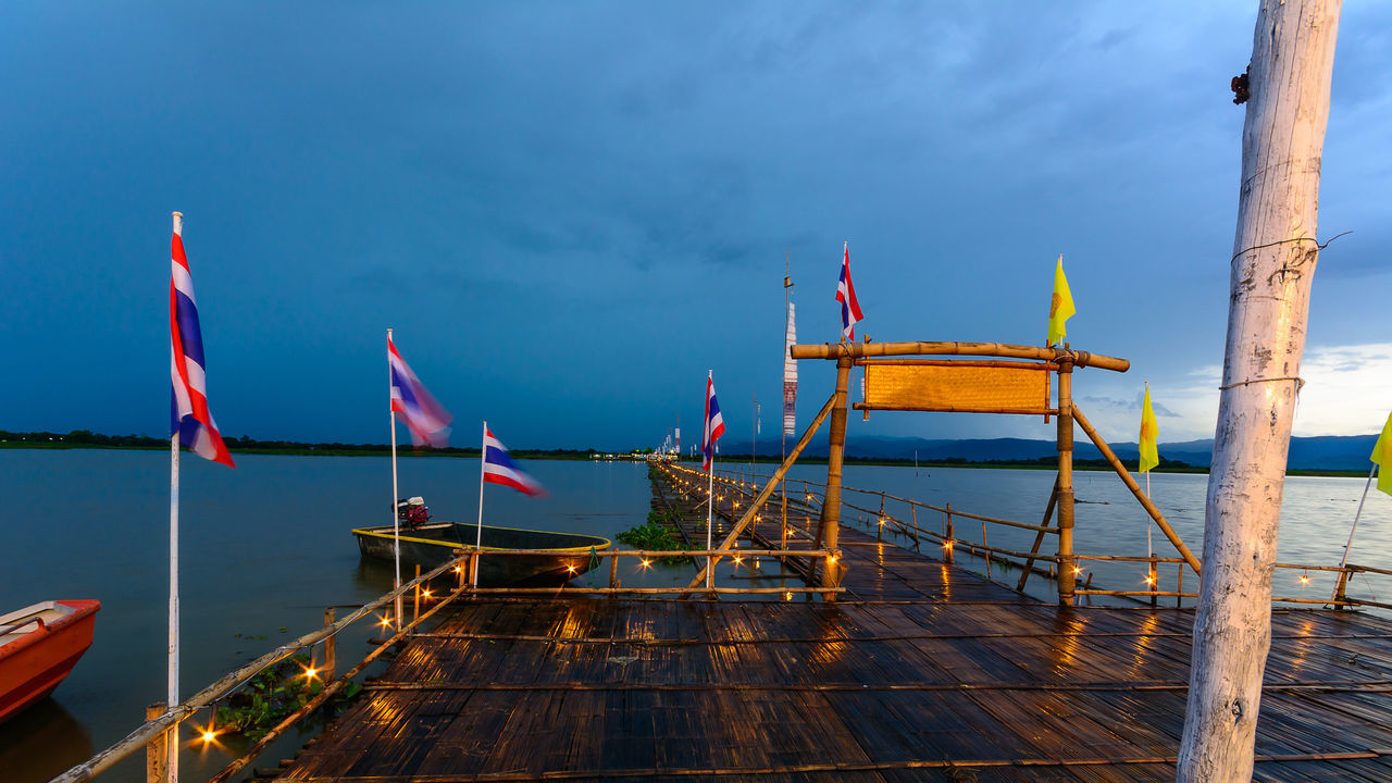 PHAYAO, THAILAND - JULY 19, 2016: The bamboo bridge, The bamboo bridge of Wat Ti Lok Aram temple in kwan phayao off freshwater lake of Thailand. Day is the important Buddhist. ASIA Bamboo Bridge Beauty In Nature Blue Boat Buddhist Cloud Cloud - Sky Day Important Jetty Kwan Phayao Nature No People Ocean Outdoors Scenics Sky Temple Thailand Tranquil Scene Tranquility Travel Destinations Wat Ti Lok Aram Water