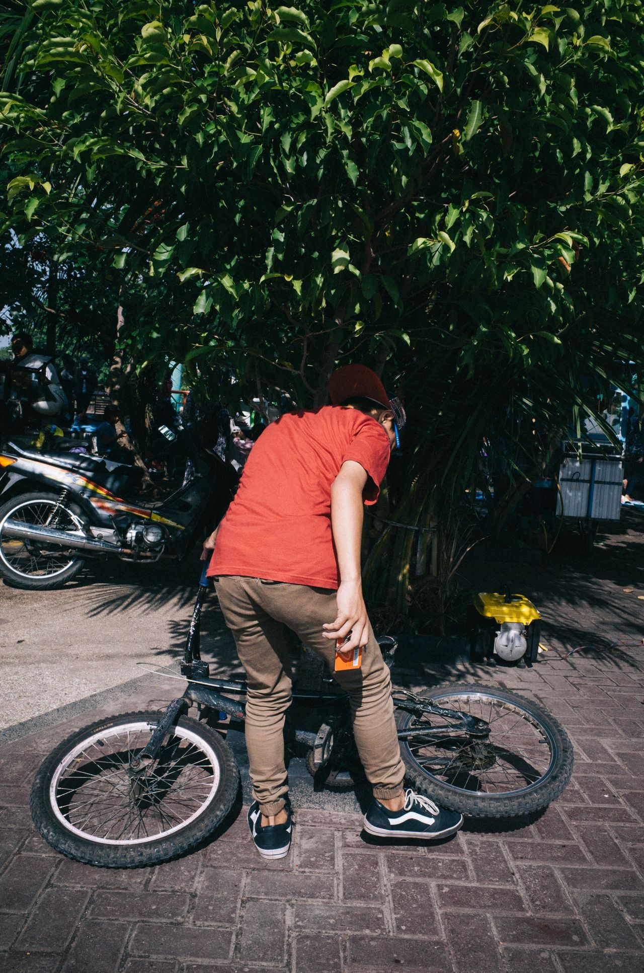 a boy in red and his bike Bicycle Cycling Transportation Mode Of Transport Casual Clothing Full Length Only Men One Man Only One Person Tree Riding Adult Outdoors Men Lifestyles Skill  Day Mountain Bike Real People Young Adult The Street Photographer - 2017 EyeEm Awards