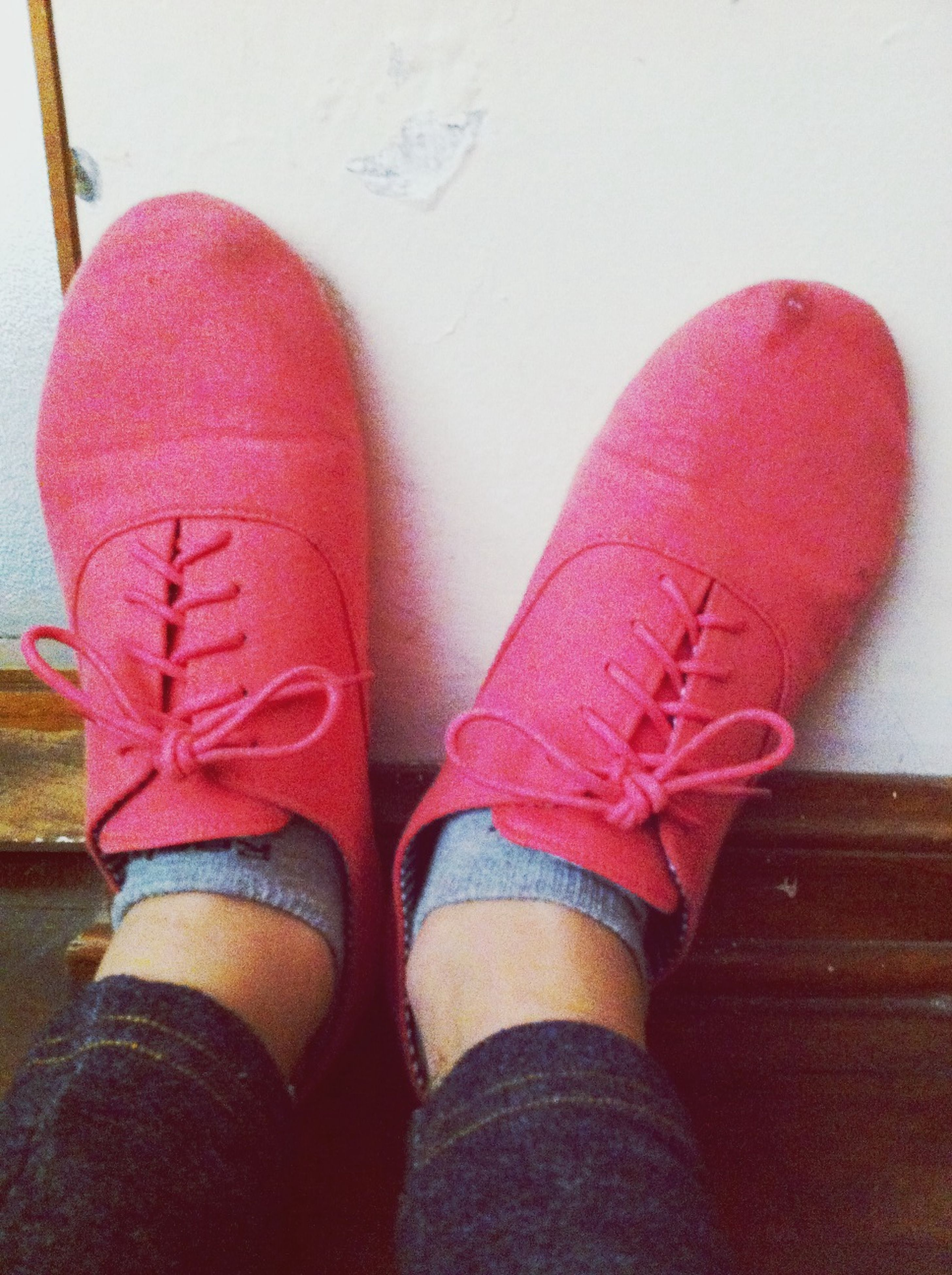 red, low section, shoe, person, indoors, personal perspective, footwear, lifestyles, close-up, standing, pink color, high angle view, part of, fashion, unrecognizable person, leisure activity