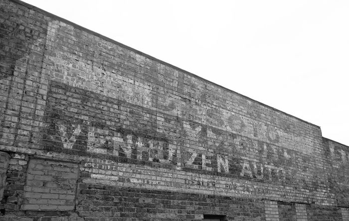 Shades of the '50's Advertising DeSoto Plymouth Defunct Dealership Building Blackandwhite