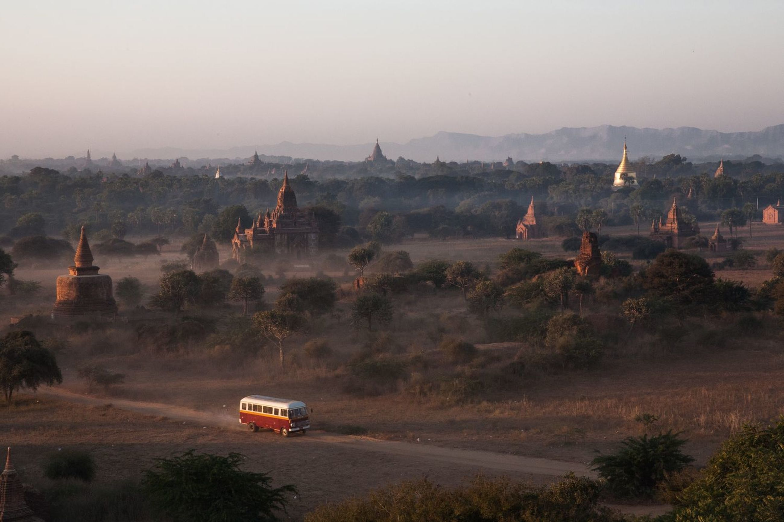 transportation, religion, landscape, place of worship, architecture, car, fog, travel, travel destinations, ancient, nature, outdoors, no people, tree, built structure, building exterior, day, hot air balloon, dawn, beauty in nature, ancient civilization, sky