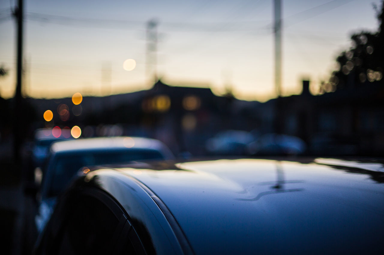 Cars and reflections Blue Hour Blue Sky Car Car Roof Car Windows Cars City Clear Sky Evening Getting Dark Glow No People Outdoors Reflection Reflection In The Window Reflective Sky Sunset Sunset Glow Twilight Yellow Glow