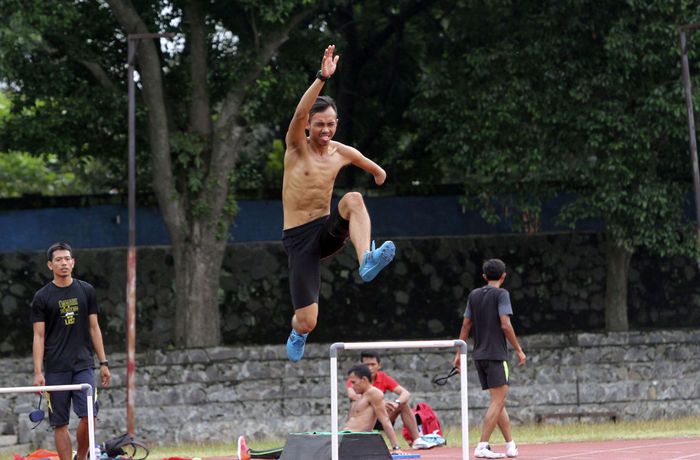athletes with disabilities were practicing in the city of Solo, Central Java, Indonesia Athlete Athletics Competition Disabled Exersice Outdoors Paralypic People Watching Sport Stadium Standing