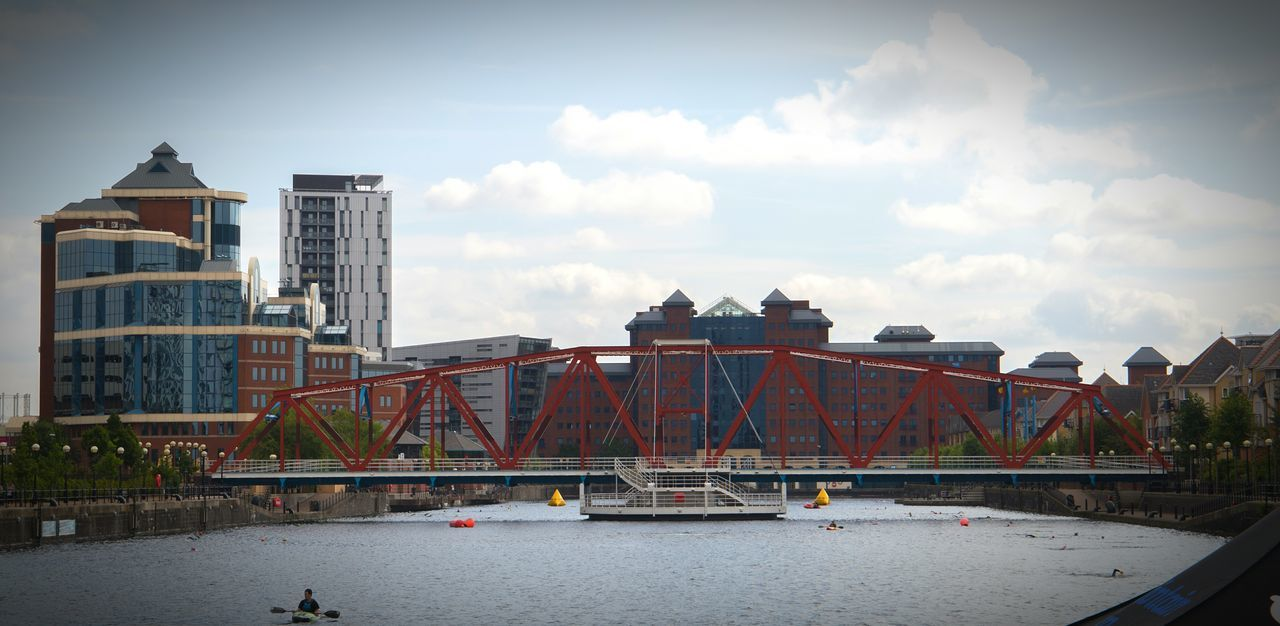 On a sunny day at MediaCityUK, the brick-red colour scheme begins to really pop. Manchester Salford Quays Mediacityuk Architecture Bridge Blue Red Brick Sky And Clouds Quayside Colour Of Life