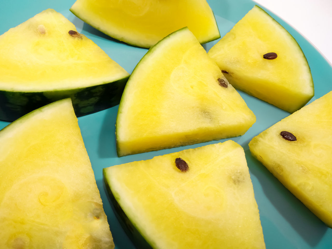 Refreshing Triangular Slices of a Juicy Yellow Watermelon on a Blue Dish Close-up Day Diet Food Food And Drink Freshness Fruit Fruitarian Healthy Healthy Eating Healthy Fruits Healthy Lifestyle Indoors  Mango No People Organic Food Organic Watermelon SLICE Summer Food Triangle Triangle Shape Triangular Slices Tropical Fruit Tropics Yellow
