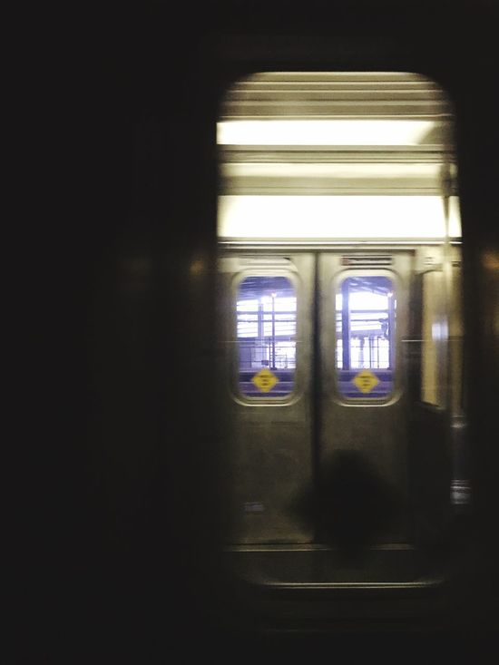 Looking into the train from the train Indoors  Window Public Transportation Transportation Train - Vehicle Illuminated No People Subway Train Day