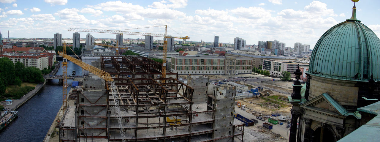 """Tearing down the """"Palace of the Republic"""" (2008) 2008 Architecture Building Exterior Built Structure Business Finance And Industry City Cityscape Day High Angle View Horizontal Modern Ruins  Outdoors Palast Der Republik Panorama People Sky Travel Destinations Urban Skyline"""