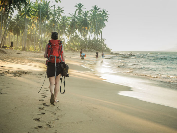 Backpacking Holiday Travel Woman Adventure Backpack Beach Day Discovery Girl Nature One Person Outdoors People Real People Sabbatical Sand Scenics Sea Walking Water