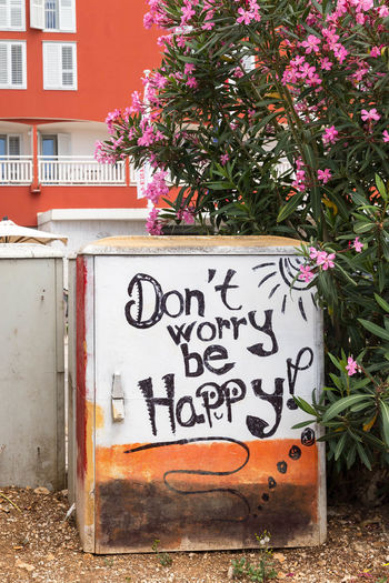 Don't worry be happy... ArtWork Croatia Don't Worry Graffiti Porec, Croatia Poreč Street Qoutes & Sayings Travel Travel Photography Architecture Art Building Exterior Built Structure Day Don't Worry Be Happy Don't Worry, Be Happy Flower Graffiti Art Growth Nature No People Outdoors Porec Qoutes Travel Photos