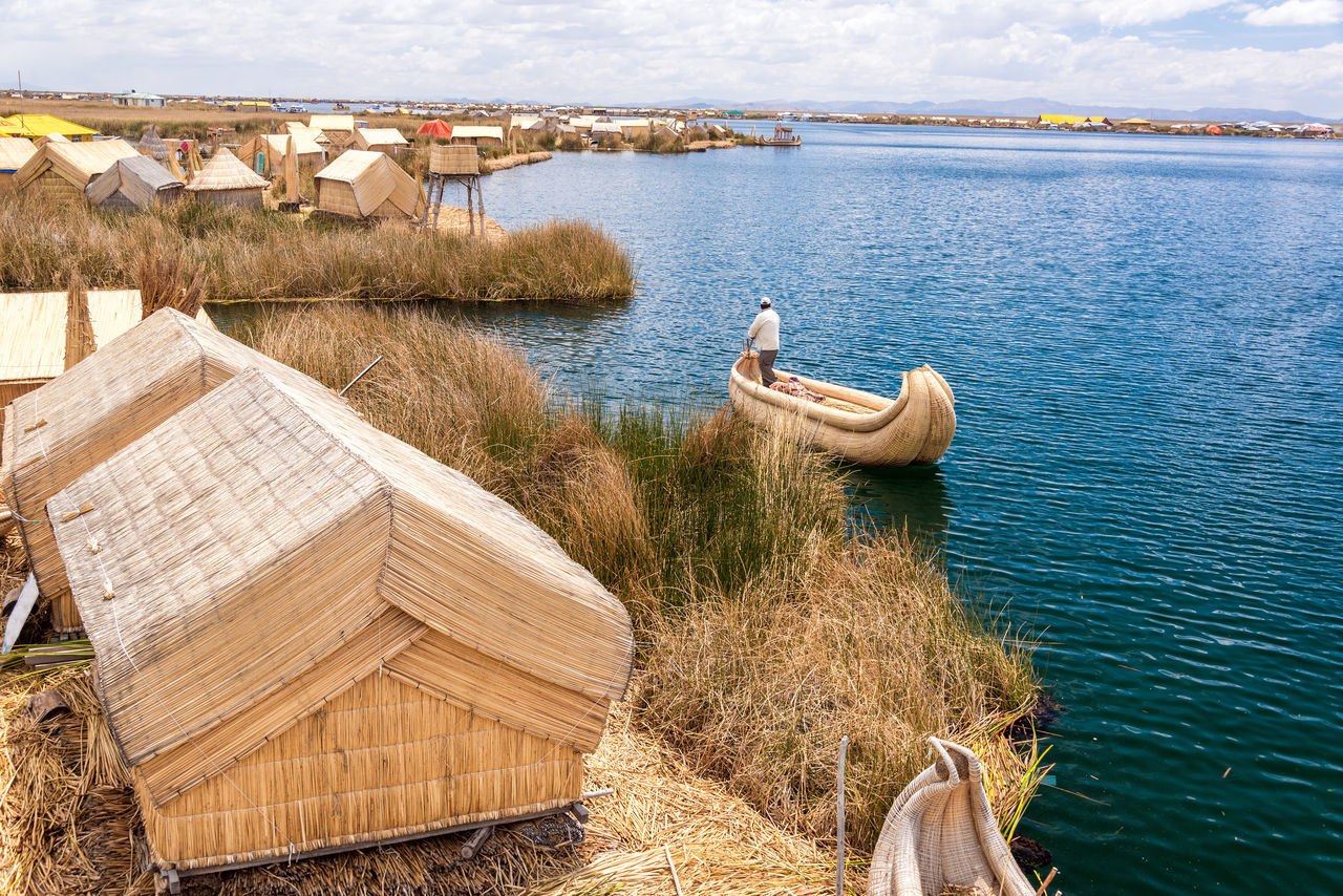 Manmade Uros floating islands on Lake Titicaca near Puno, Peru America Andes Boat Destination Floating Inca Lake Landscape Latin Native Nature Peru Peruvian Puno Puno, Perú Reed Scenic Sky Titicaca Titicaca Lake Totora Travel Uros Uros Island Water