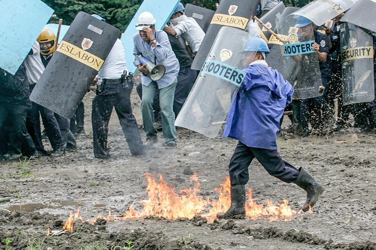 The Photojournalist - 2017 EyeEm Awards Illegal settlers throw molotov cocktails and stones to security guards in Taguig City Philippines during demolition of houses in Taguig City Philippines. Urban poor groups stage protest to call on the attention of the local government against demolition or clearing of homes of informal settlers even without the necessary demolition order.