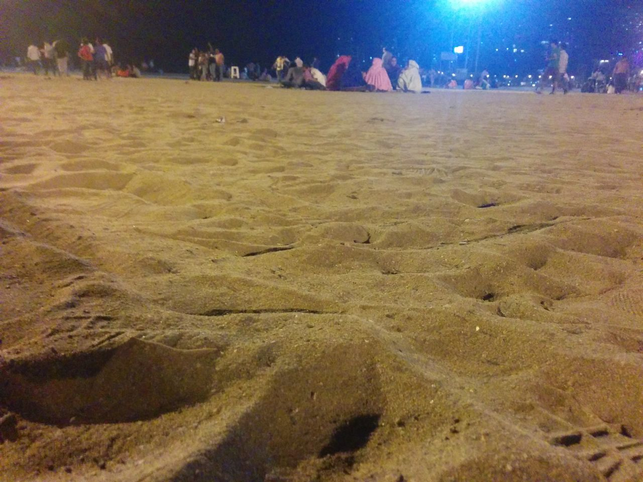 large group of people, sand, beach, night, men, real people, leisure activity, women, outdoors, illuminated, nature, crowd, people, adult, adults only