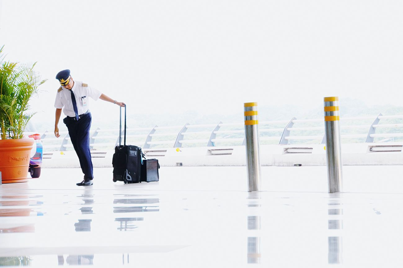 Crewless Miles Away Travel Pilot Airport Luggage Journey Full Length People And Places Uniform One Person White Background Work From My Point Of View Uniqueness EyeEm Best Shots People Getting Inspired Adventure People Photography Airport Terminal Lifestyles Light And Shadow The City Light Shootermag Long Goodbye Let's Go. Together.