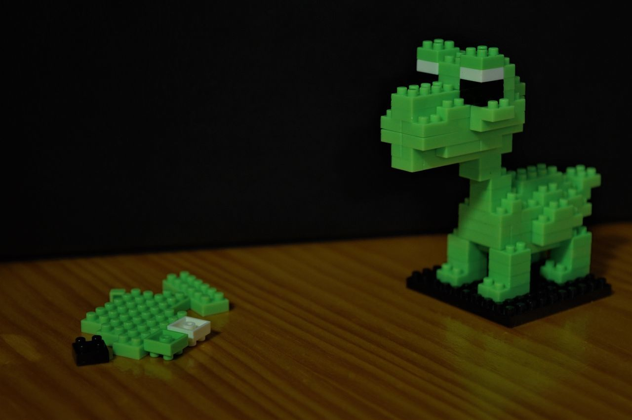 """hmmmm... are those not meant to fit somewhere?"" Black Block Blocks Colour Connect Creative Creativity Dinosaur Figurine  Finished Product Fun Green Green Color Indoors  No People Small Tiny Toy Toy Block Toy Photography Toys White Wood"