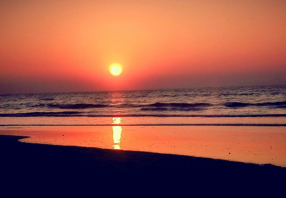 Sunset Sea Horizon Over Water Reflection Beauty In Nature Water Dramatic Sky Sun Scenics Beach Nature Sky Orange Color Tranquility Outdoors Sunlight Tranquil Scene Romantic Sky No People Day