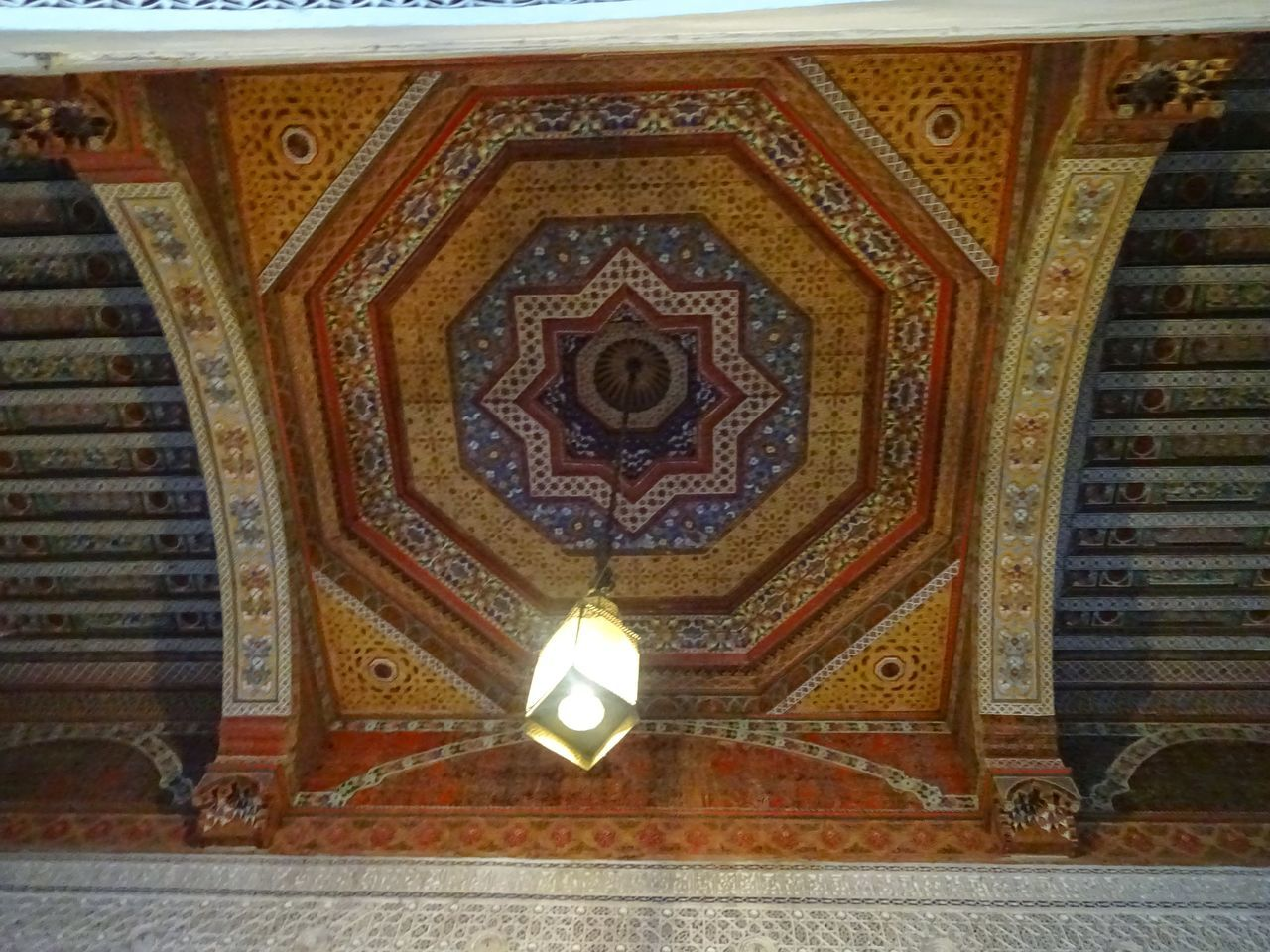indoors, design, art and craft, ceiling, religion, low angle view, pattern, ornate, no people, spirituality, place of worship, architecture, illuminated, built structure, day, close-up