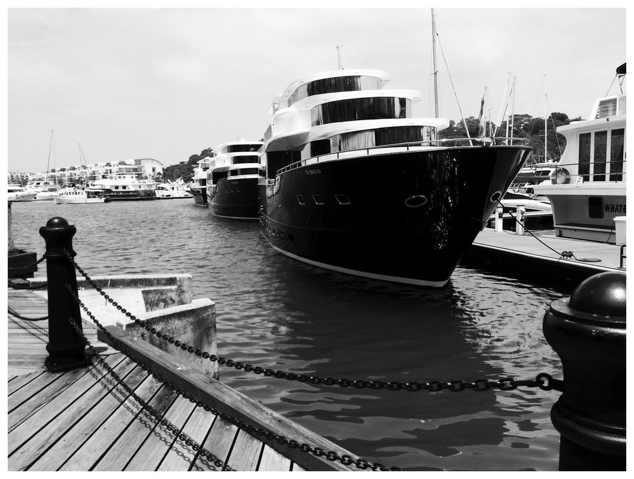 Ships Moored In River By Pier