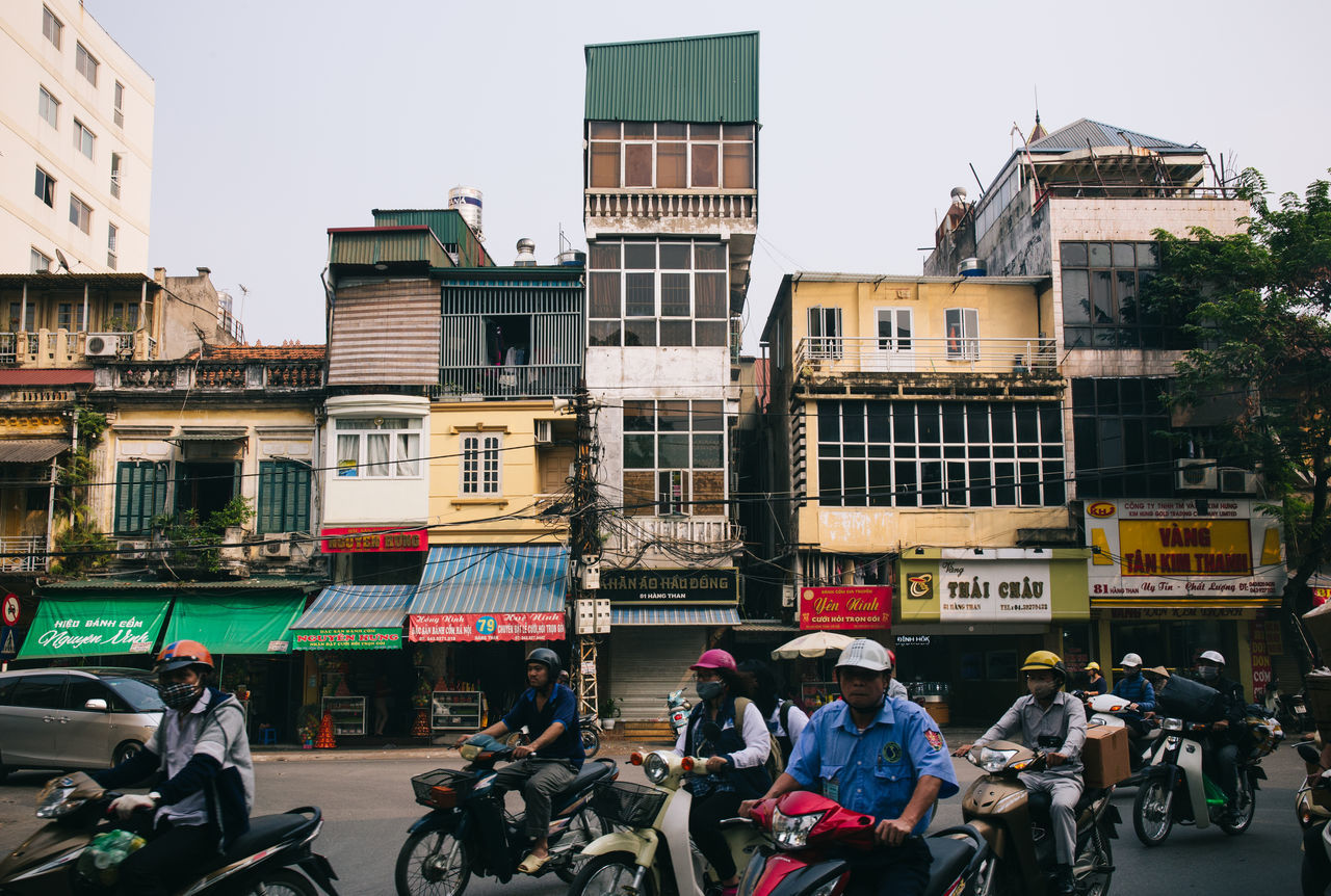 City Street in Hanoi, Vietnam Architecture Bicycle Building Exterior Buildings City City City Life Day Dense Density Driving Hanoi Mode Of Transport Motorcycles Outdoors People Scooter Traffic Transport Transportation Travel Urban Vacation Vietnam Vietnamese The Architect - 2017 EyeEm Awards The Photojournalist - 2017 EyeEm Awards The Street Photographer - 2017 EyeEm Awards Let's Go. Together.