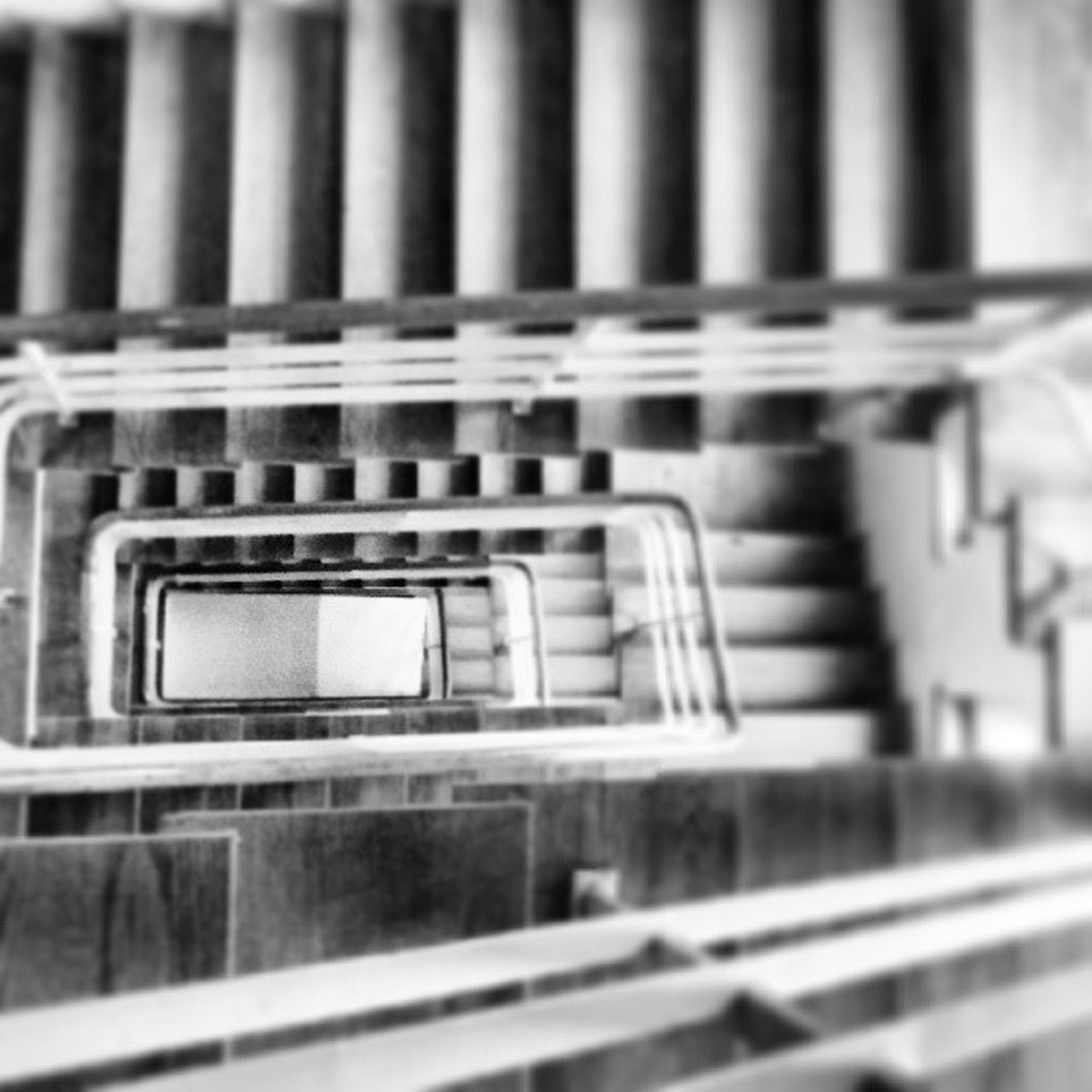 railing, built structure, architecture, steps, building exterior, metal, steps and staircases, close-up, selective focus, staircase, indoors, window, reflection, focus on foreground, no people, building, day, pattern, metallic