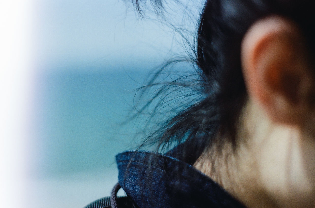 close-up day human body part human hair Nature one person outdoors real people sea and sky sky sunny day