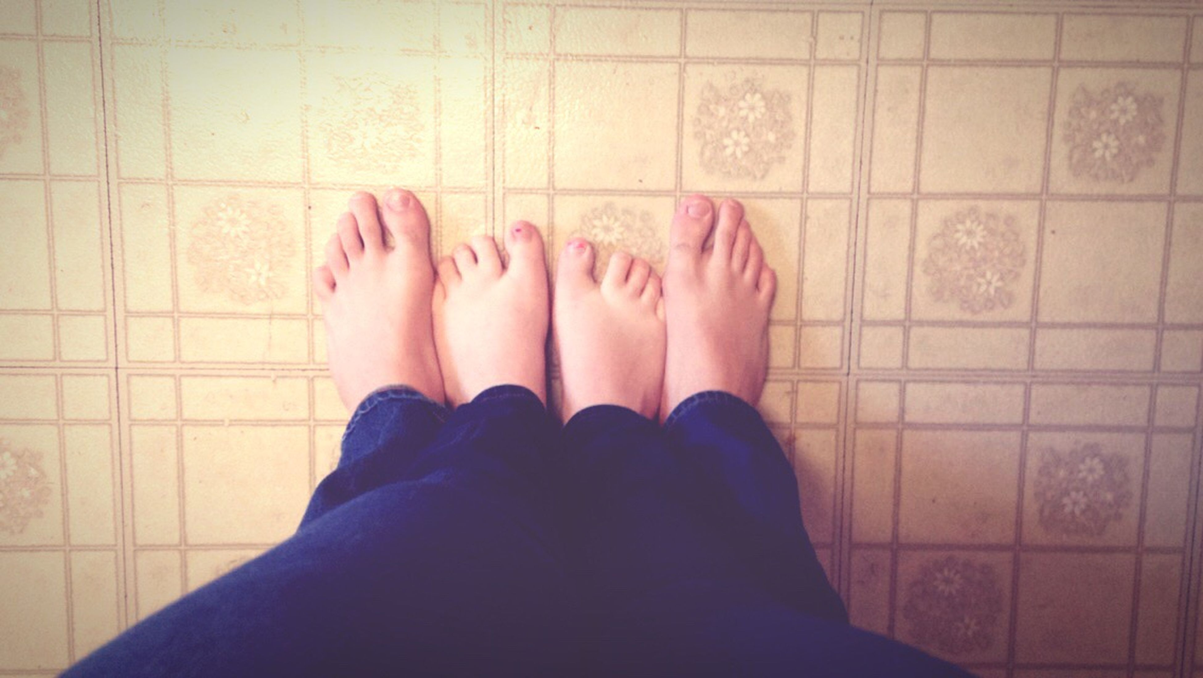 low section, person, personal perspective, human foot, indoors, lifestyles, barefoot, shoe, tiled floor, standing, relaxation, high angle view, leisure activity, flooring, part of, directly above