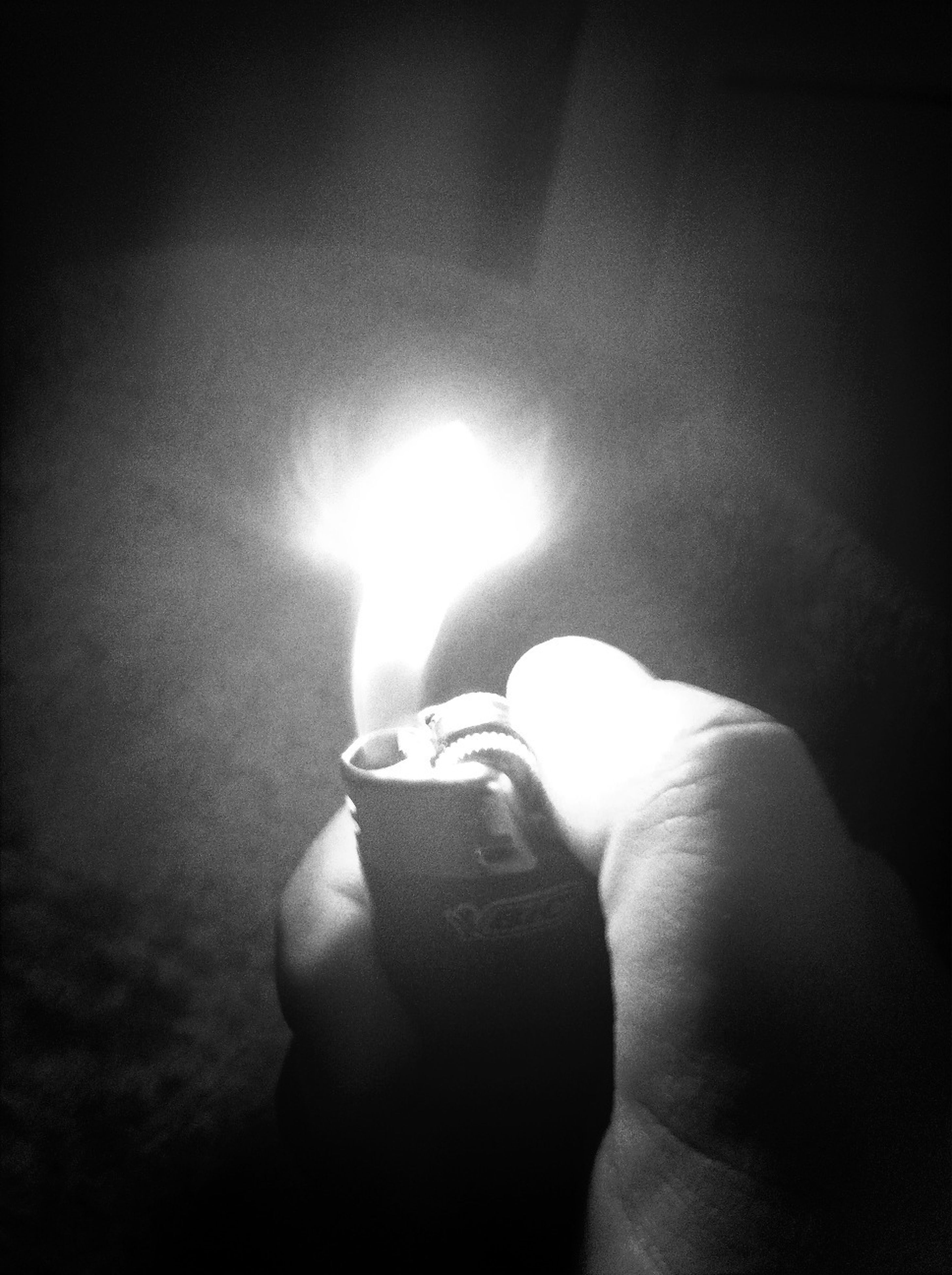 person, holding, indoors, lifestyles, leisure activity, men, part of, unrecognizable person, human finger, illuminated, glowing, night, close-up, dark, cropped