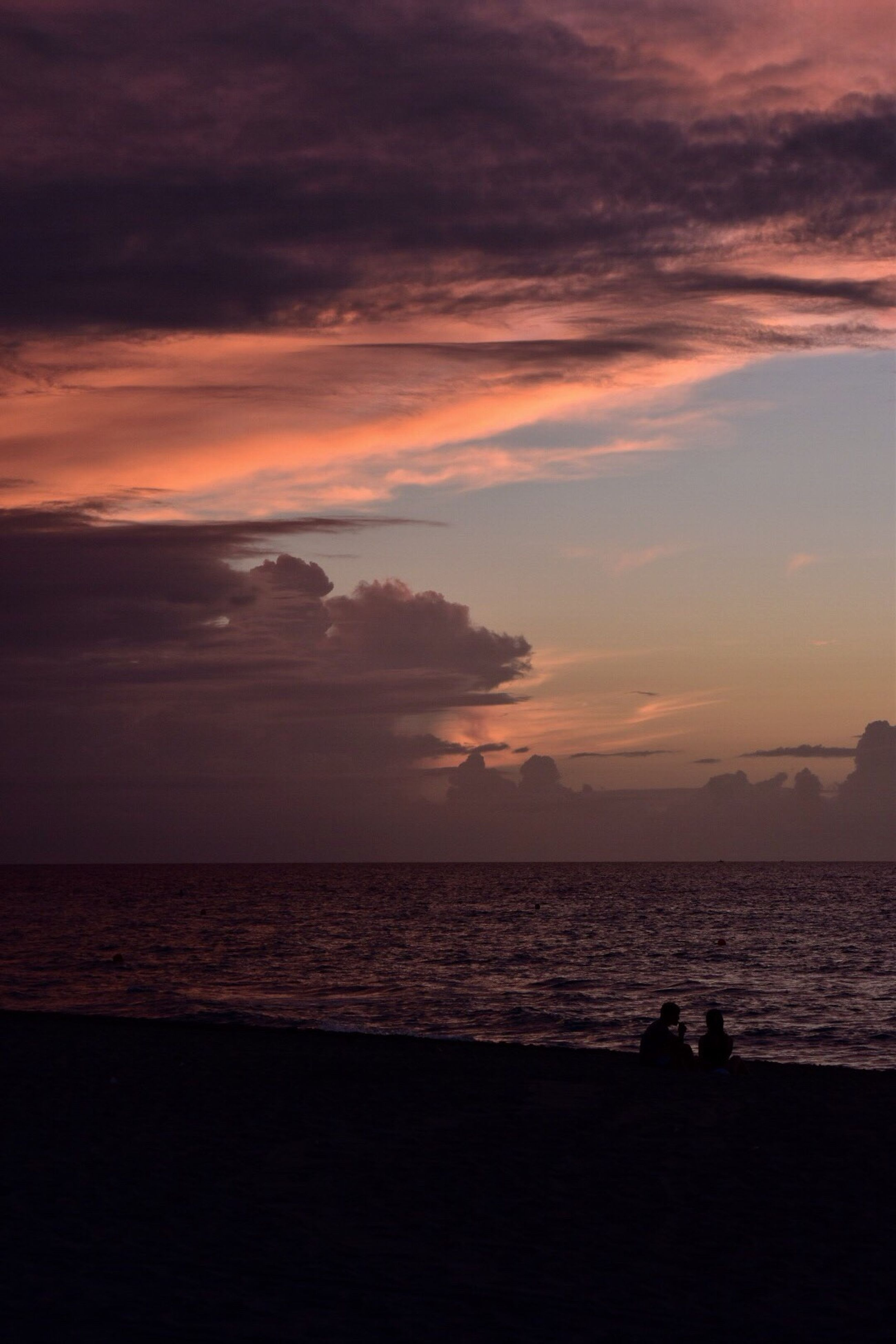 sunset, sea, silhouette, beach, nature, beauty in nature, sky, scenics, tranquil scene, tranquility, horizon over water, water, outdoors, people