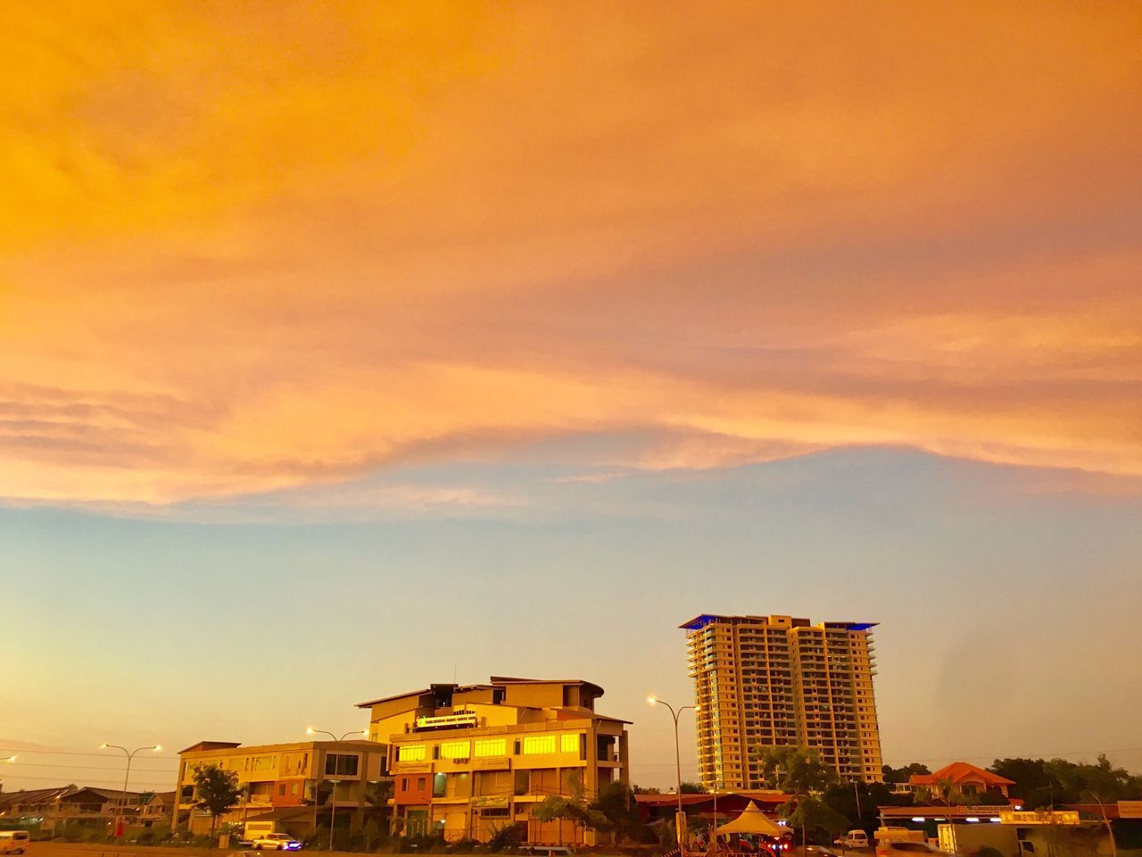 architecture, building exterior, built structure, sky, sunset, no people, cloud - sky, city, outdoors, cityscape, illuminated, nature, day