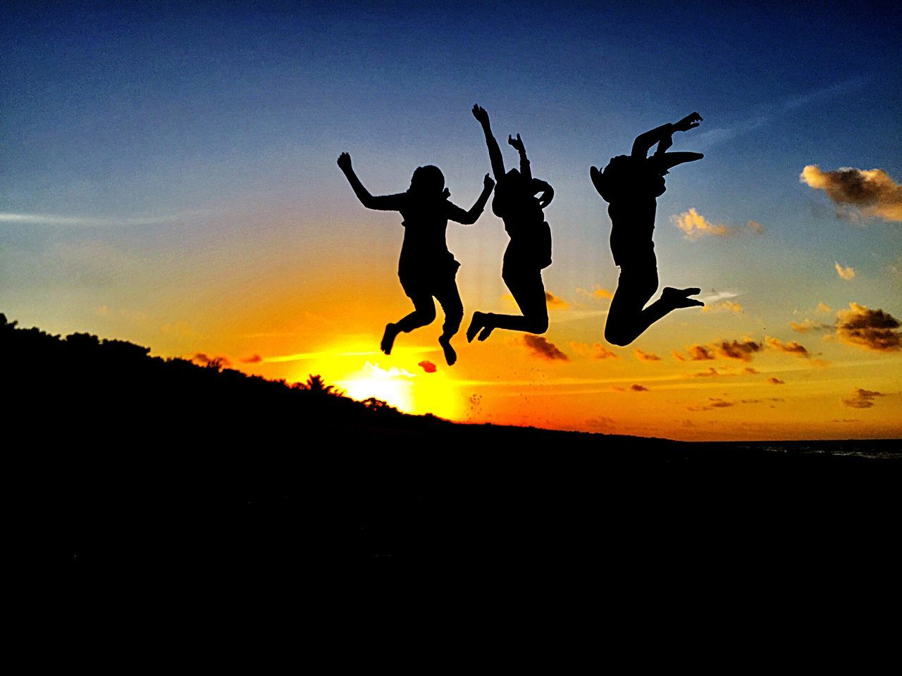 silhouette, sunset, energetic, jumping, full length, mid-air, nature, togetherness, vitality, excitement, sky, men, enjoyment, outdoors, real people, beauty in nature, day, people