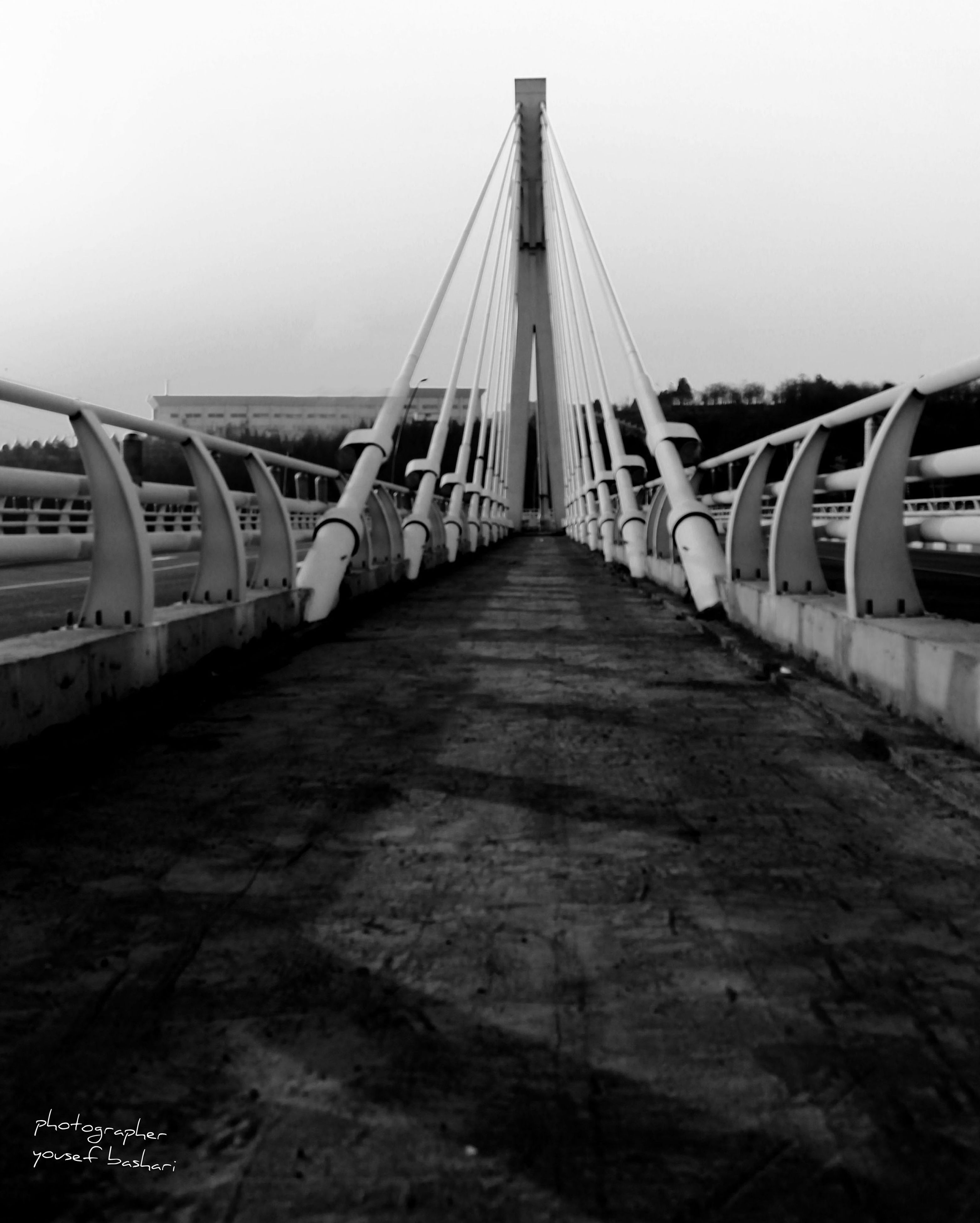 transportation, bridge - man made structure, connection, water, engineering, built structure, the way forward, architecture, clear sky, river, sea, diminishing perspective, bridge, long, suspension bridge, pier, nautical vessel, travel, mode of transport, travel destinations
