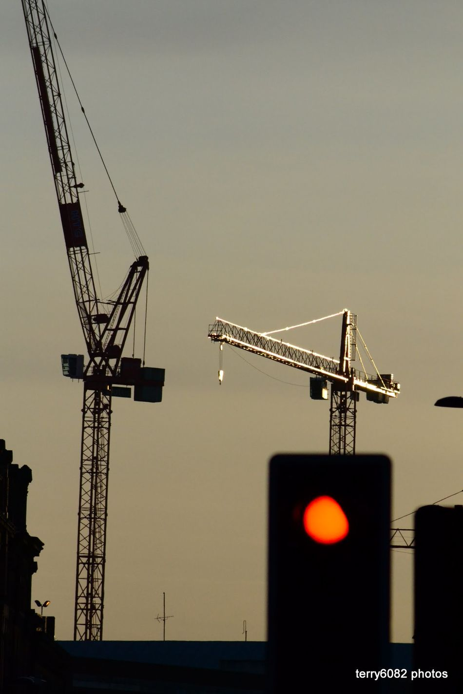 Architecture Building Exterior Built Structure City Construction Construction Machinery Construction Site Crane Crane - Construction Machinery Day Development Illuminated Industrial Equipment Industry Low Angle View Machinery No People Outdoors Progress Sky Stoplight Sunset