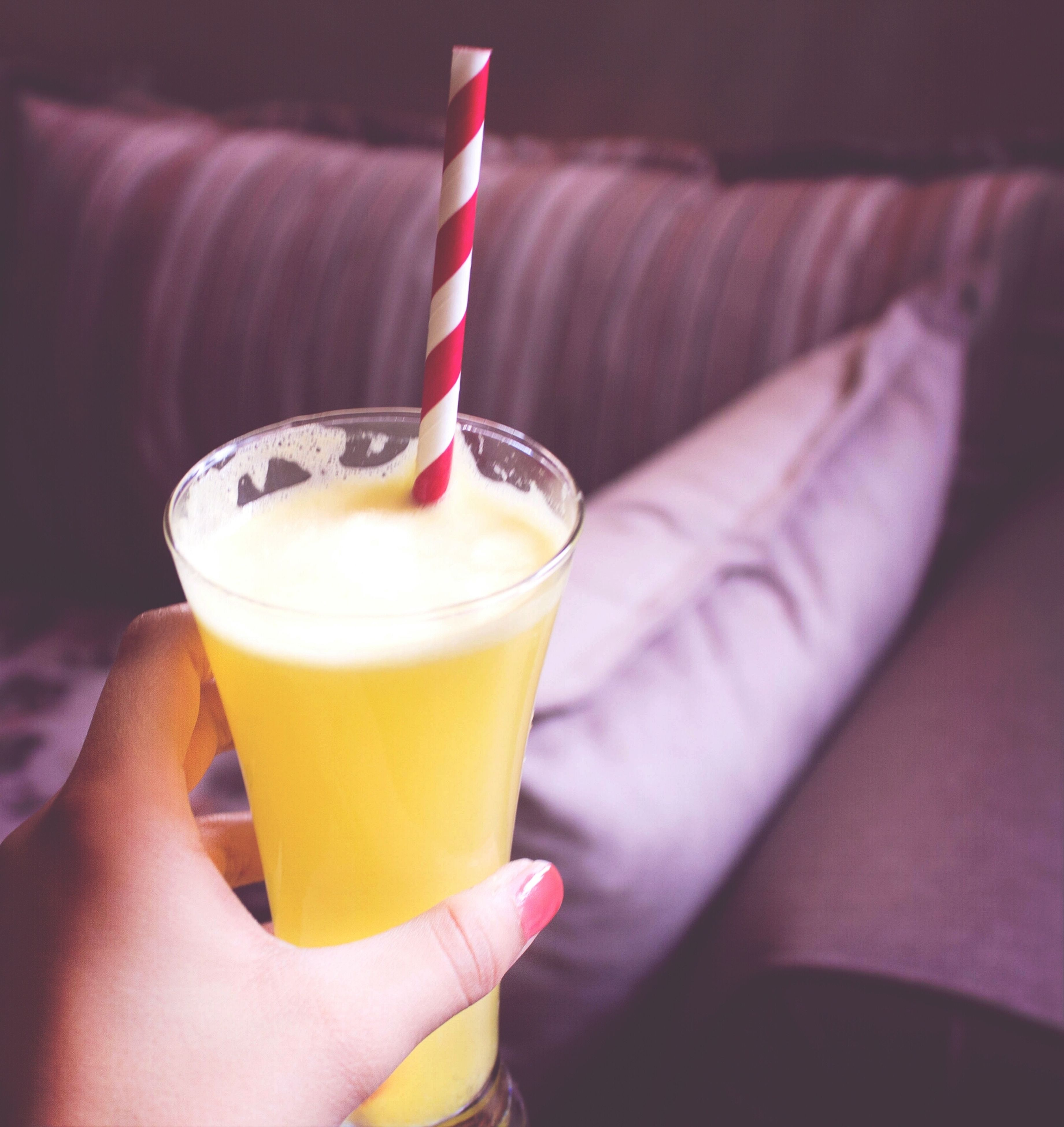food and drink, drink, refreshment, freshness, person, indoors, drinking glass, close-up, table, holding, part of, drinking straw, focus on foreground, indulgence, sweet food, cropped, still life