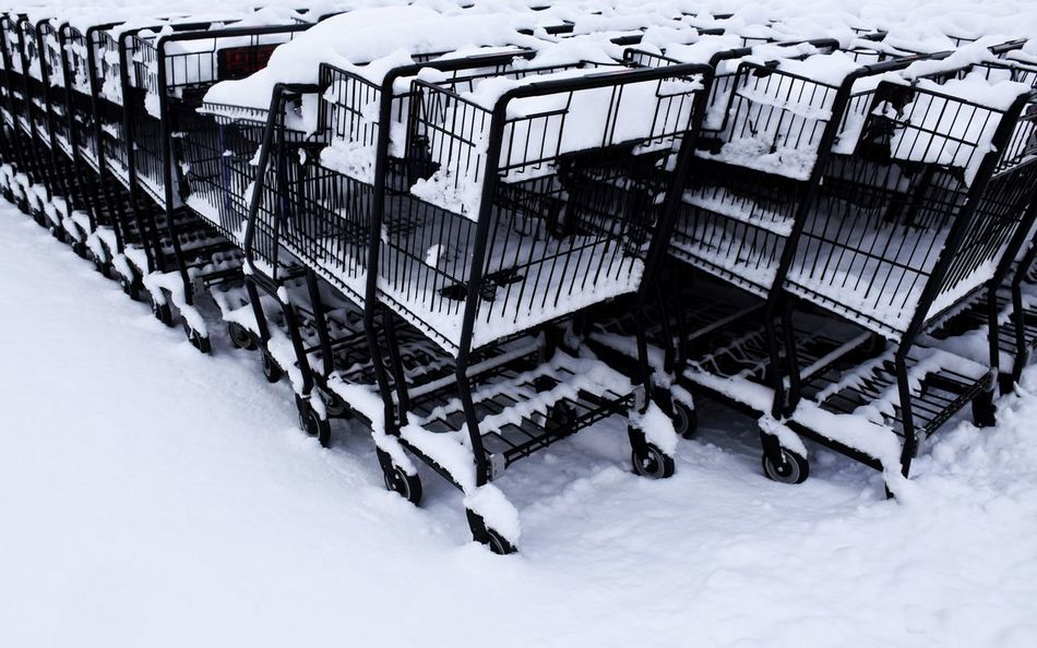 out of use Black And White Black Outlines Blackandwhite Cold Temperature Dead Of Winter Emptiness Frozen Outdoors Linear No People Out Of Use  Outdoors Perspective Shopping Carts Shopping Carts In A Row Snow Snow Covered Stacked Up Supermarket Shopping Carts Trolleys Wet Metal Winter