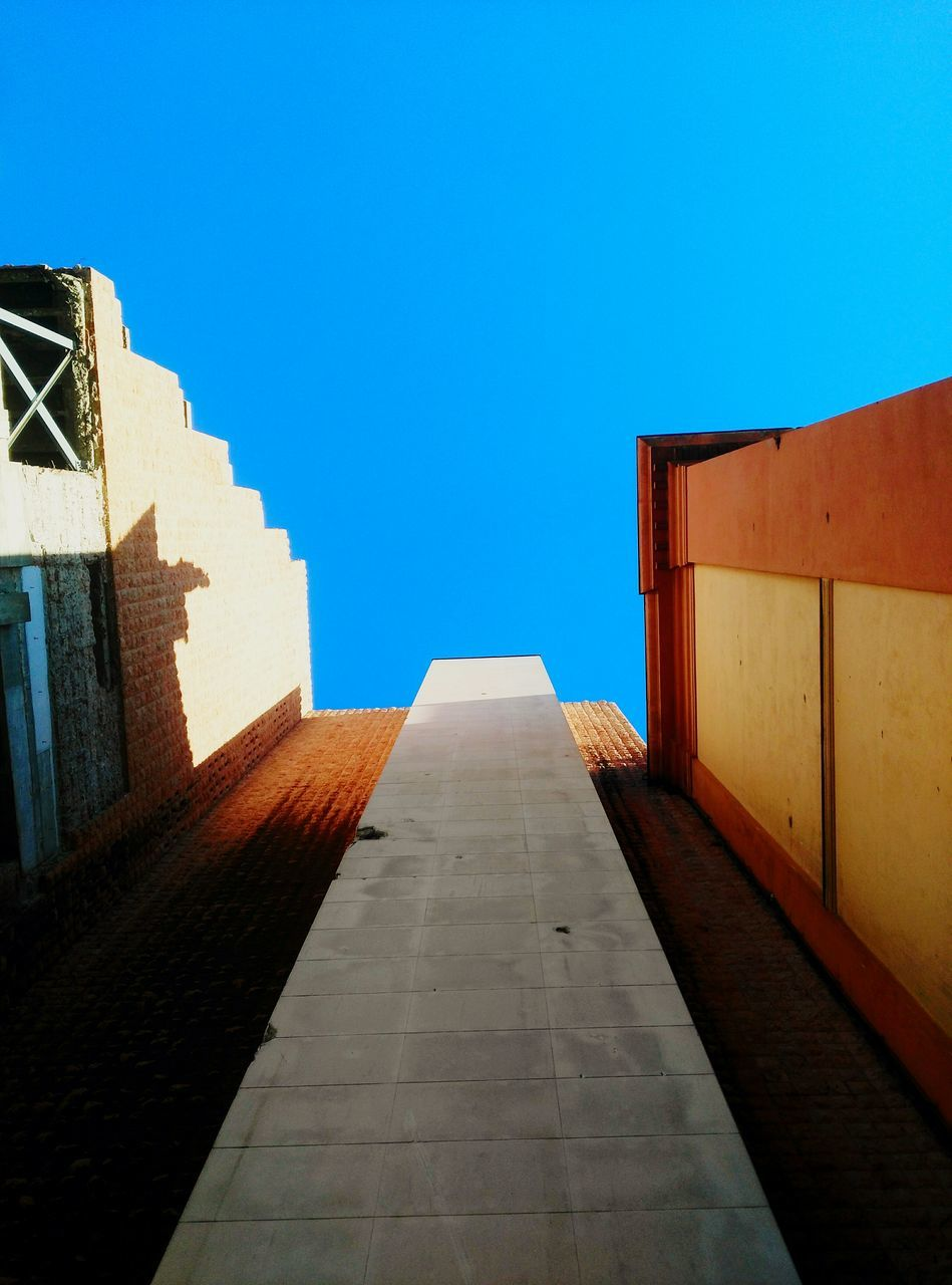 architecture, built structure, clear sky, sunlight, day, blue, no people, building exterior, outdoors