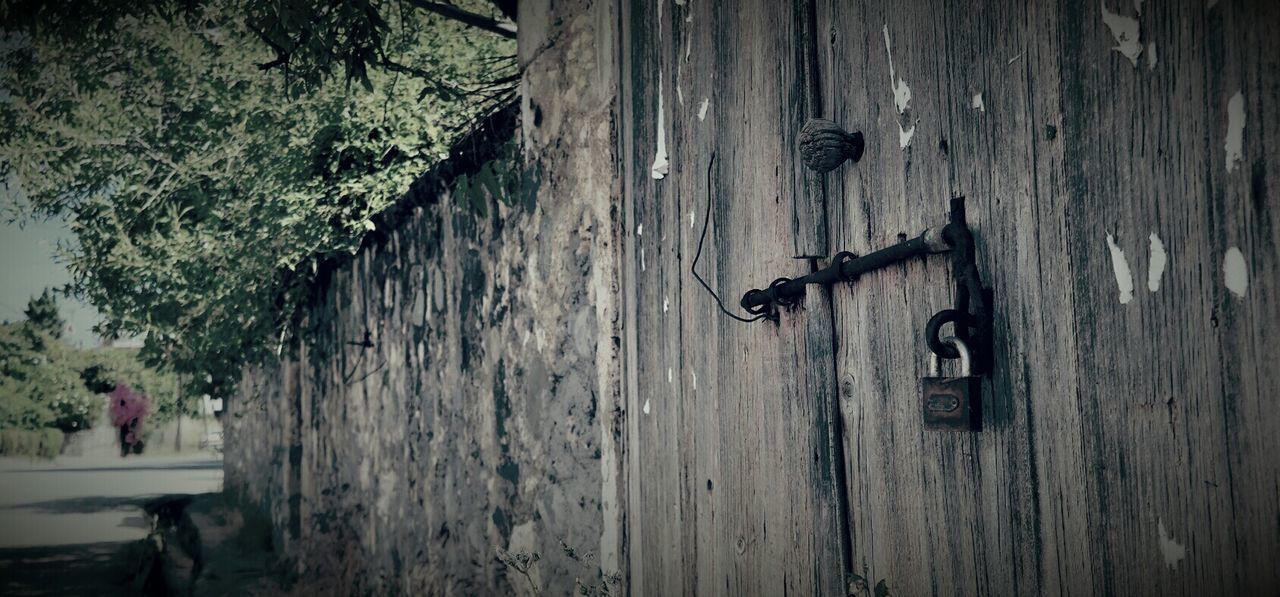 Locked Latch On Wooden Door