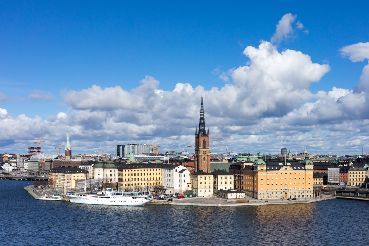 Beautiful clouds and clear sky of Stockholm during the spring. View from the hill of Sodermalm towards the Riddarholmen island and Gamla Stan, Old Town. City Cityscape Cityscapes Cityspaces Destination Europe Island Nordic Countries Riddarholmen Scandinavia Sea Stockholm Sweden Travel Waterfront