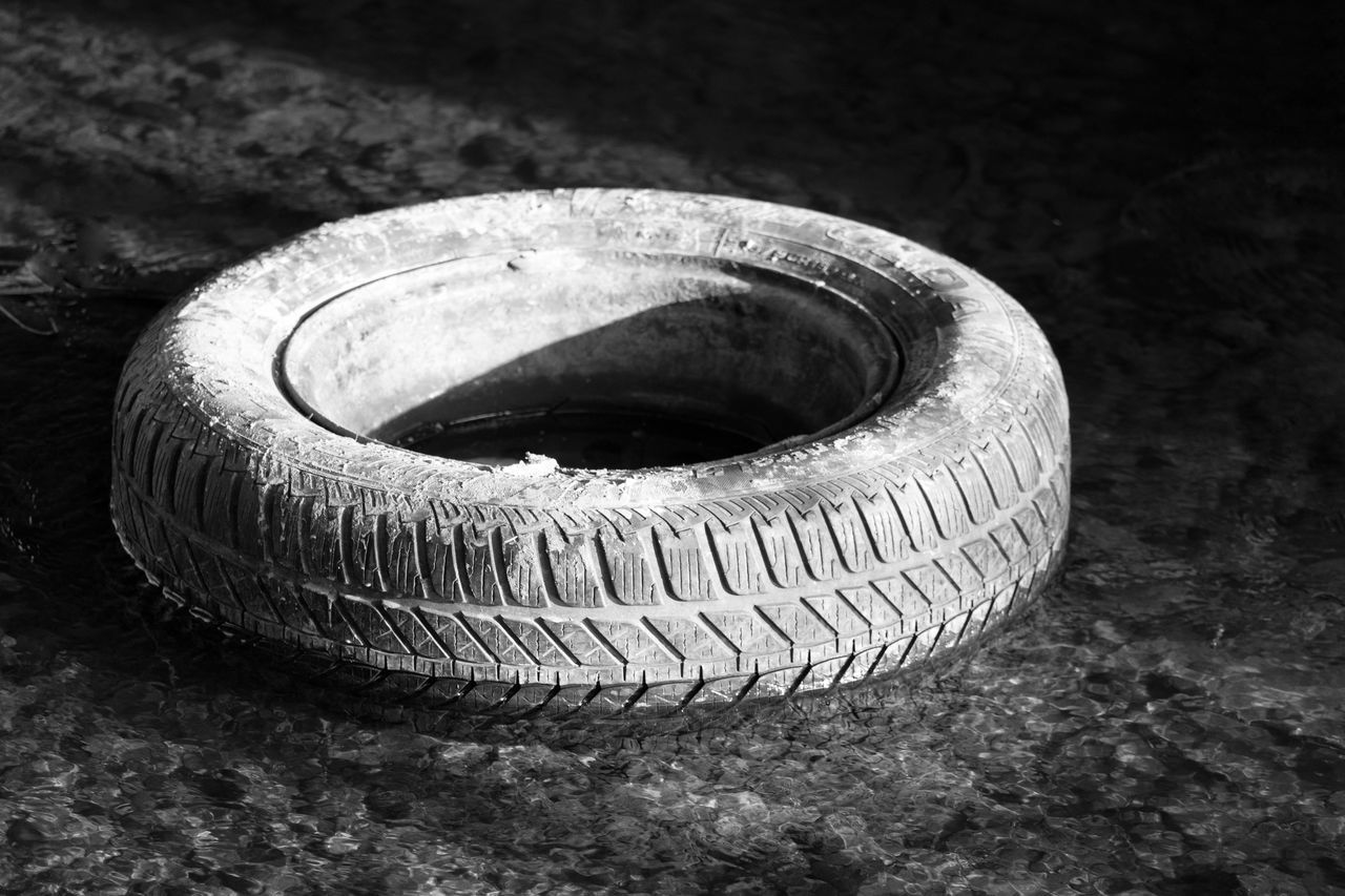 Abandoned Black Background Close-up No People Circle Tyre Car Tyre River Dumped In River Dumped Black And White Monochrome_london Shadows Garbage Car Part Shape Shame Fly Tipping Circle Circular Rubber Tyre Day Water Environmental Issues