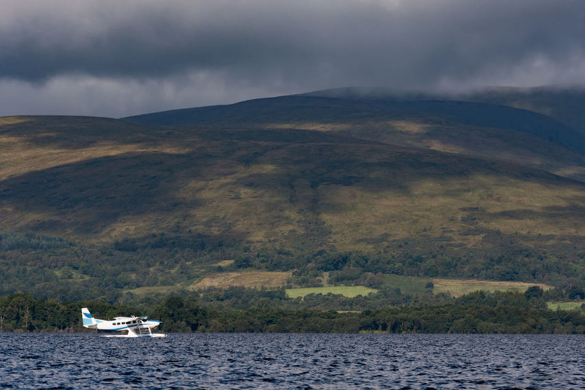 Loch Lomond seaplane taking off under a moody sky Mountain Nautical Vessel Landscape No People Outdoors Lake Day Tree Water Scenics Sky Nature Tranquil Scene Scotland Transportation Copy Space Travel Destinations Loch Lomond Sea Plane Plane TakeOff Tourism Tranquility Moody Sky Highlands Of Scotland