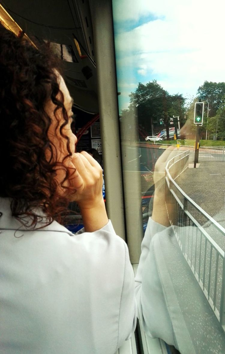Person Sky Young Adult Human Hair Looking Reflection_collection Reflecting Public Transportation On A Bus
