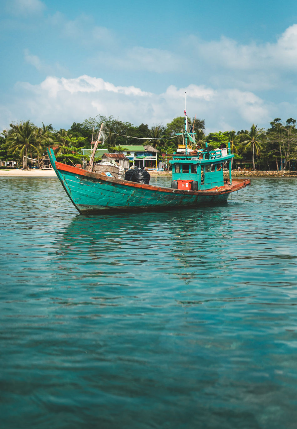 Cambodia fishing boats are swagged out 💯 Nautical Vessel Cloud - Sky Sea Water Transportation Tourism Travel Outdoors Travel Destinations Vacations Beach Nature Sky No People Day Travel Photography Cambodia Vacations Showcase: April Tropical ASIA Nautical Fisherman Travel Neon