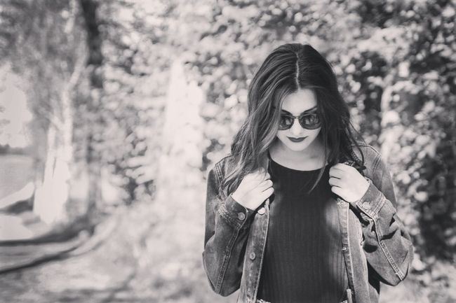 Portrait Fashion Long Hair Beauty One Person Teenager Tree Nature Young Adult Sunglasses Outdoors Day Only Women Hipster Front View Focus On Foreground Lifestyles Atmospheric Mood Casual Clothing Confidence  Sexappeal Black And White Collection