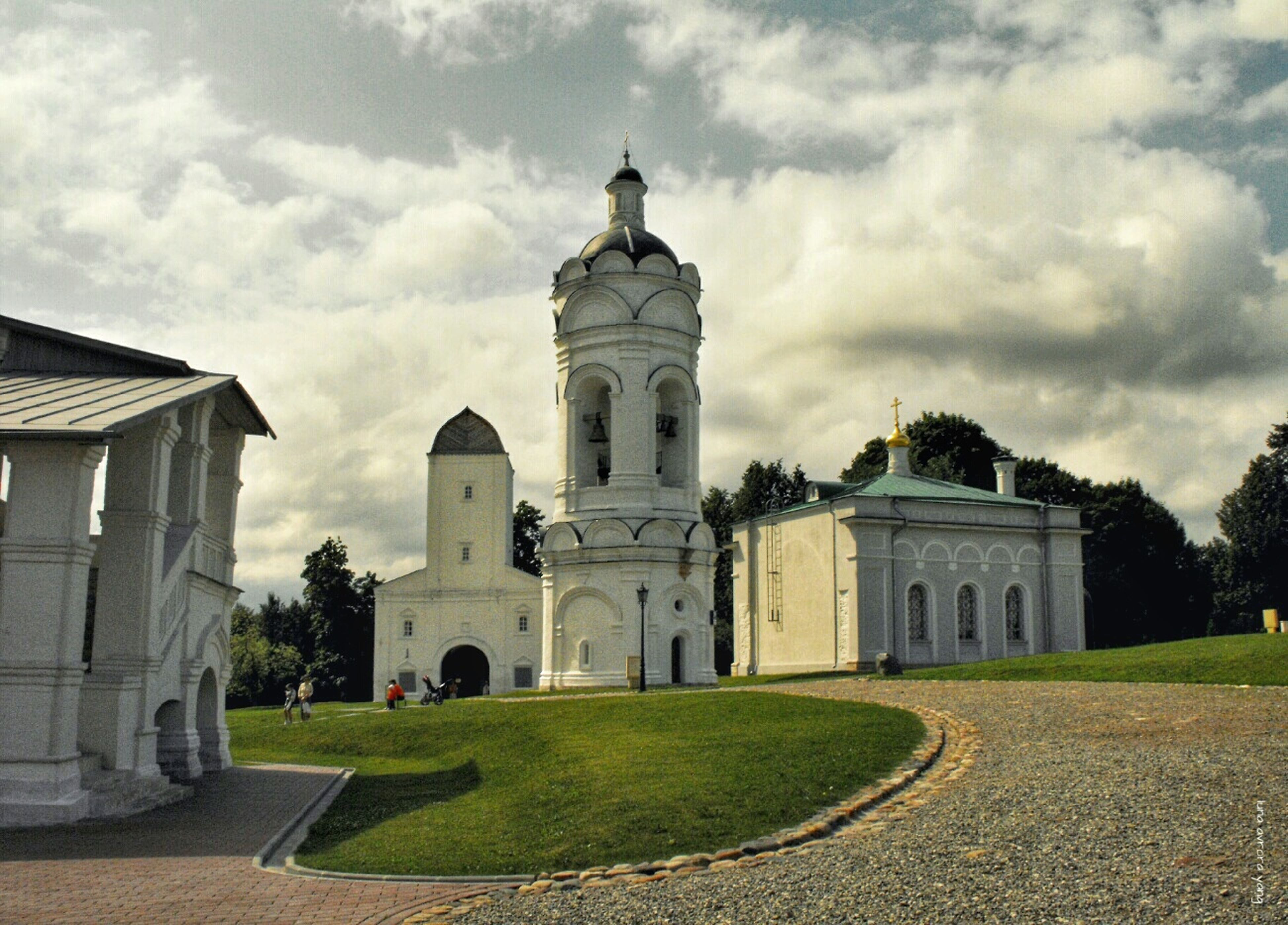 architecture, building exterior, built structure, sky, cloud - sky, grass, cloudy, history, cloud, lawn, church, facade, religion, dome, day, arch, outdoors, place of worship, tree, incidental people