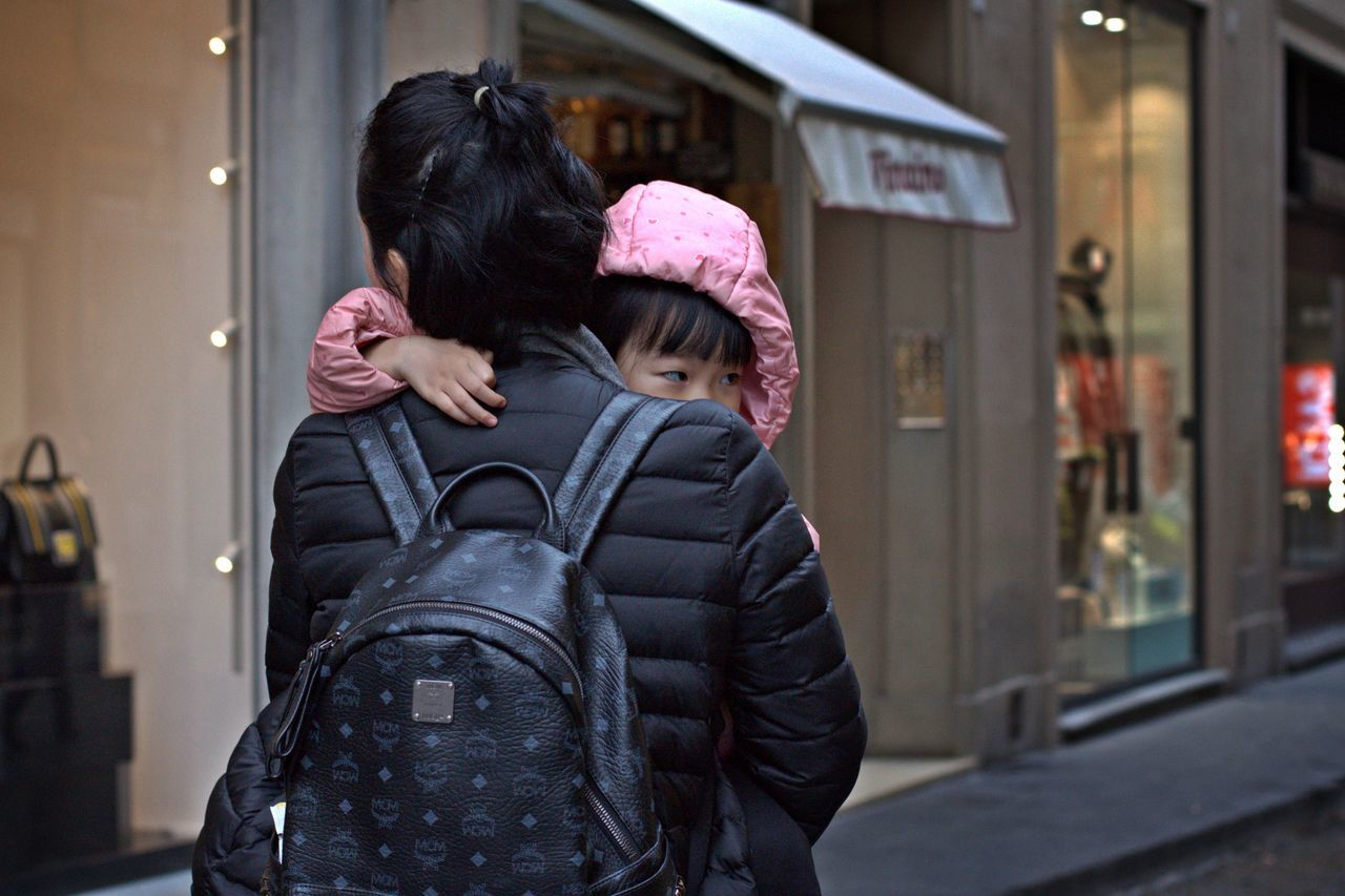 two people, real people, togetherness, love, mother, leisure activity, bonding, women, lifestyles, childhood, building exterior, warm clothing, outdoors, built structure, architecture, day, smiling, people