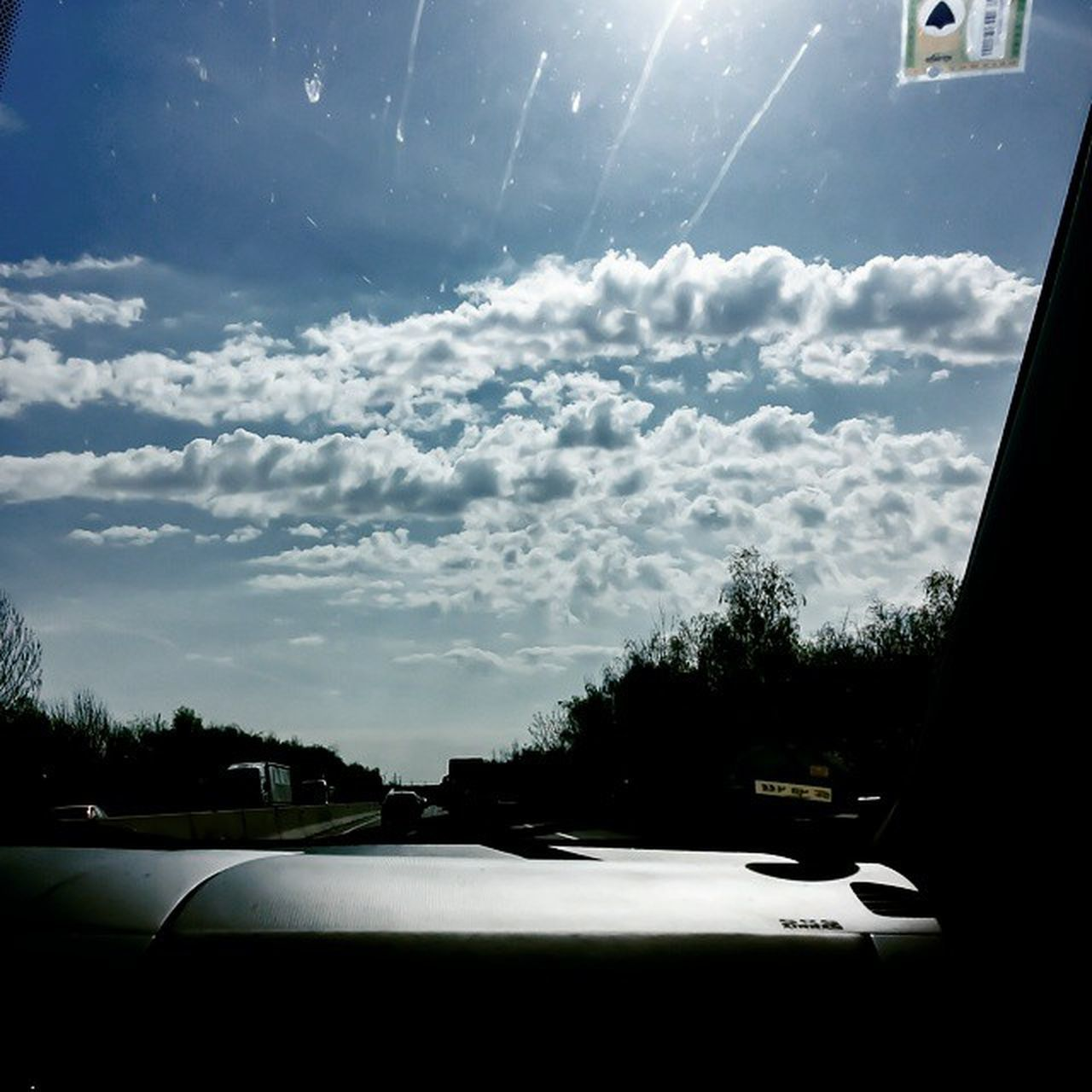 car, transportation, land vehicle, car interior, vehicle interior, cloud - sky, windshield, mode of transport, sky, car point of view, road, day, no people, nature, tree, dashboard, beauty in nature, outdoors