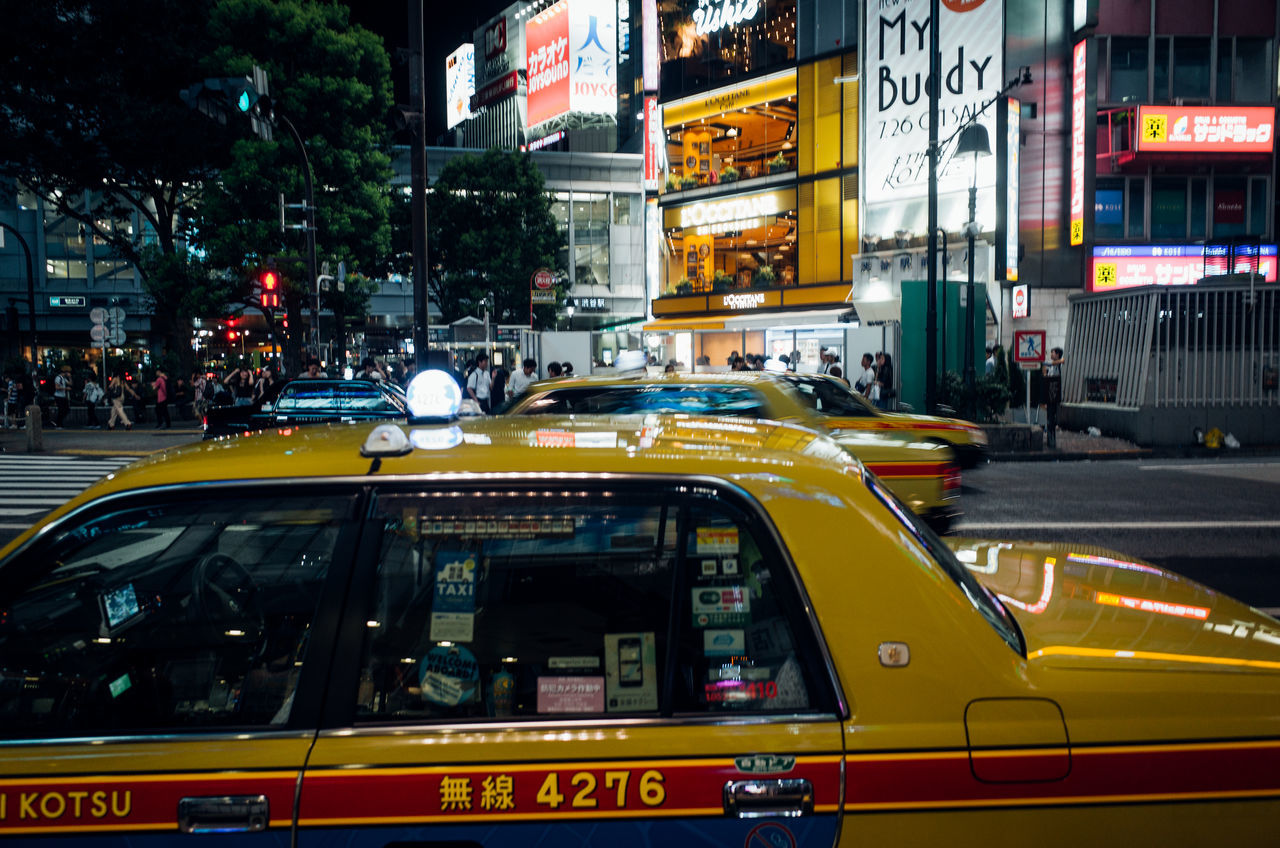 Shibuyascapes ◀️🚕🌃🇯🇵 Color Redefining Yellow Deep Colors New Vintage Taxi On The Road Atmospheric Mood EyeEm Best Shots The Journey Is The Destination Shibuya Japan Night EyeEm Gallery Car City Day Illuminated Incidental People Land Vehicle Outdoors People Street Transportation Cityscape EyeEm Selects