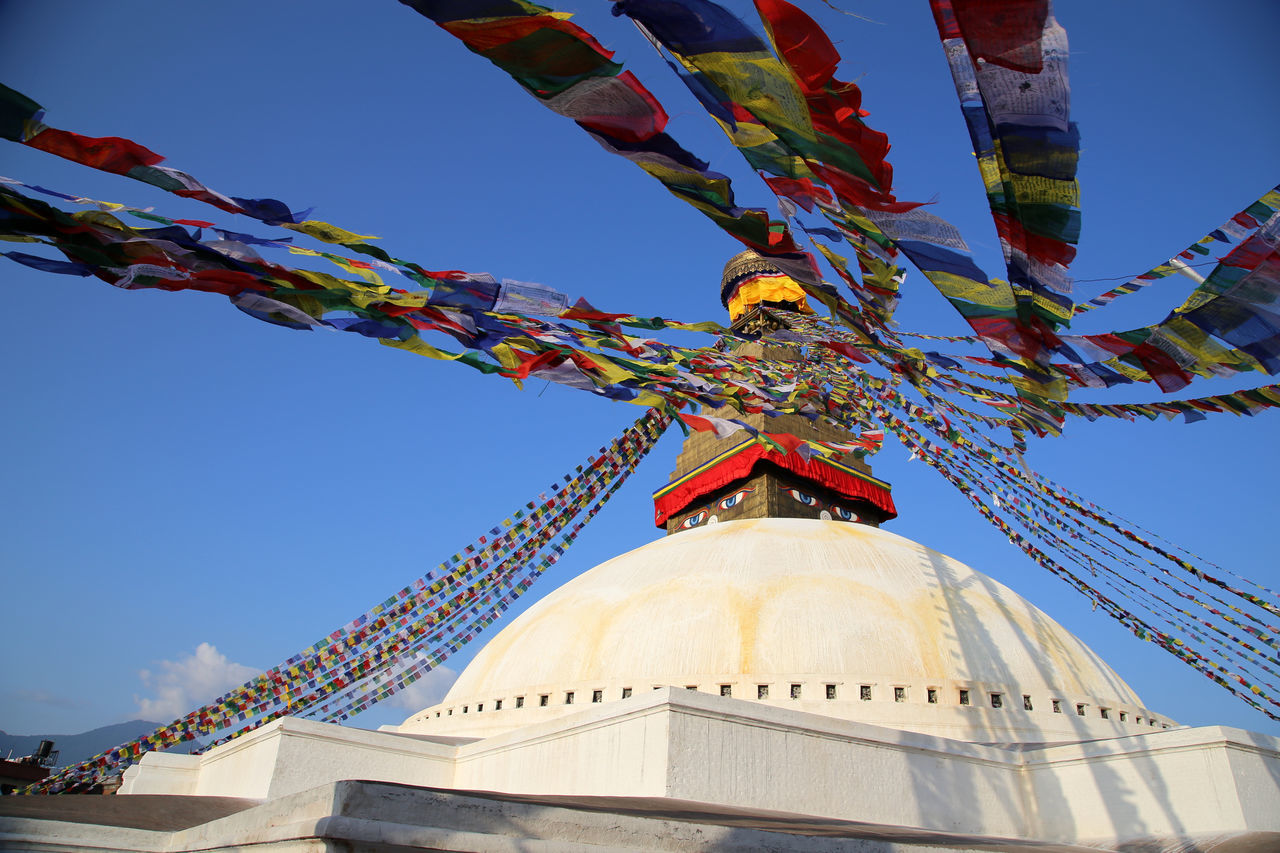 Boudhanath stupa with prayer flags and white Architectural Feature Bodnath Buddha's Compassionate Eyes Boudanath StupaCompassionate Gebetsfahnen Gebetsfähnchen Kathmandu Kathmandu, Nepal Low Angle View Nepal Nepal TravelPilgrimage Place Of Worship Prayer Flag Prayer Flag Pole Prayer Flags  Religion Spirituality Bodnath Stupa Colour Of Life BUDDHISM IS LOVE Beauty In Architecture Kathmandu Valley Boudhanath