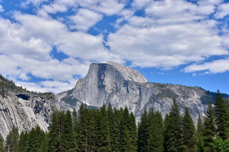 Mountain Sky Scenics Nature Cloud - Sky Beauty In Nature Tranquil Scene Tree Tranquility No People Mountain Range Day Outdoors Landscape Low Angle View Physical Geography Forest Snow Range Half Dome Yosemite National Park